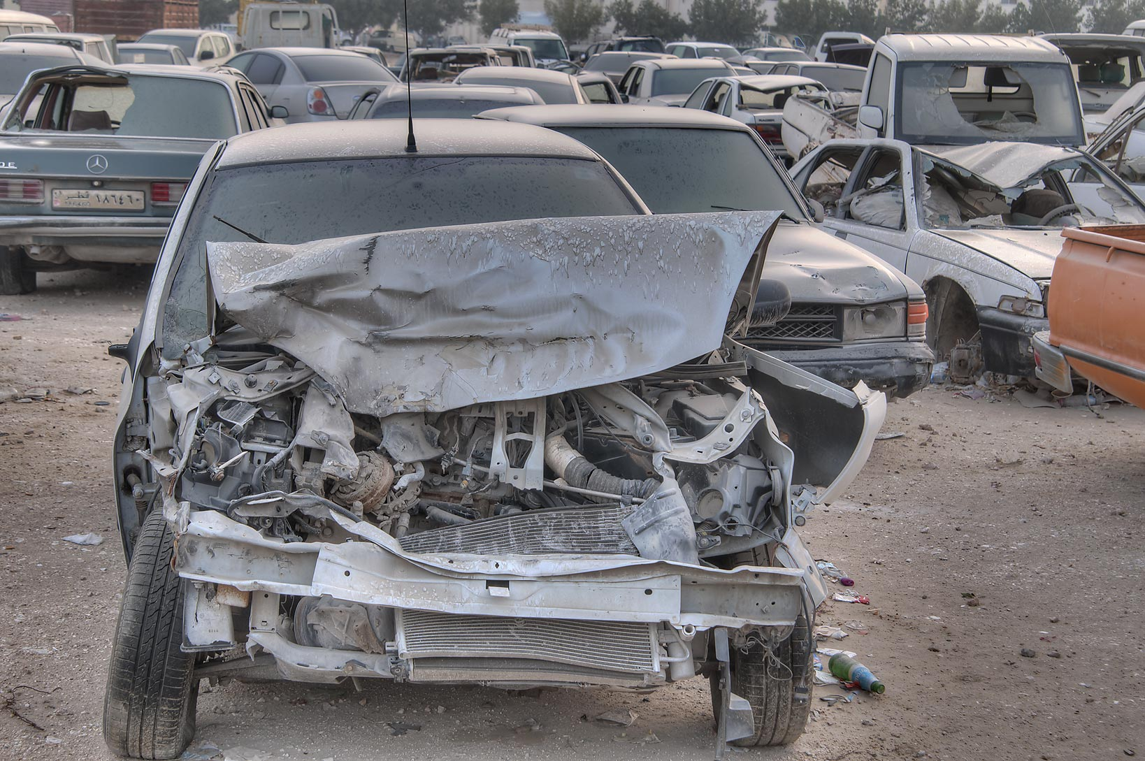 Damaged cars near Al Mamoura Traffic Police and...Division, Traffic Patrol). Doha, Qatar