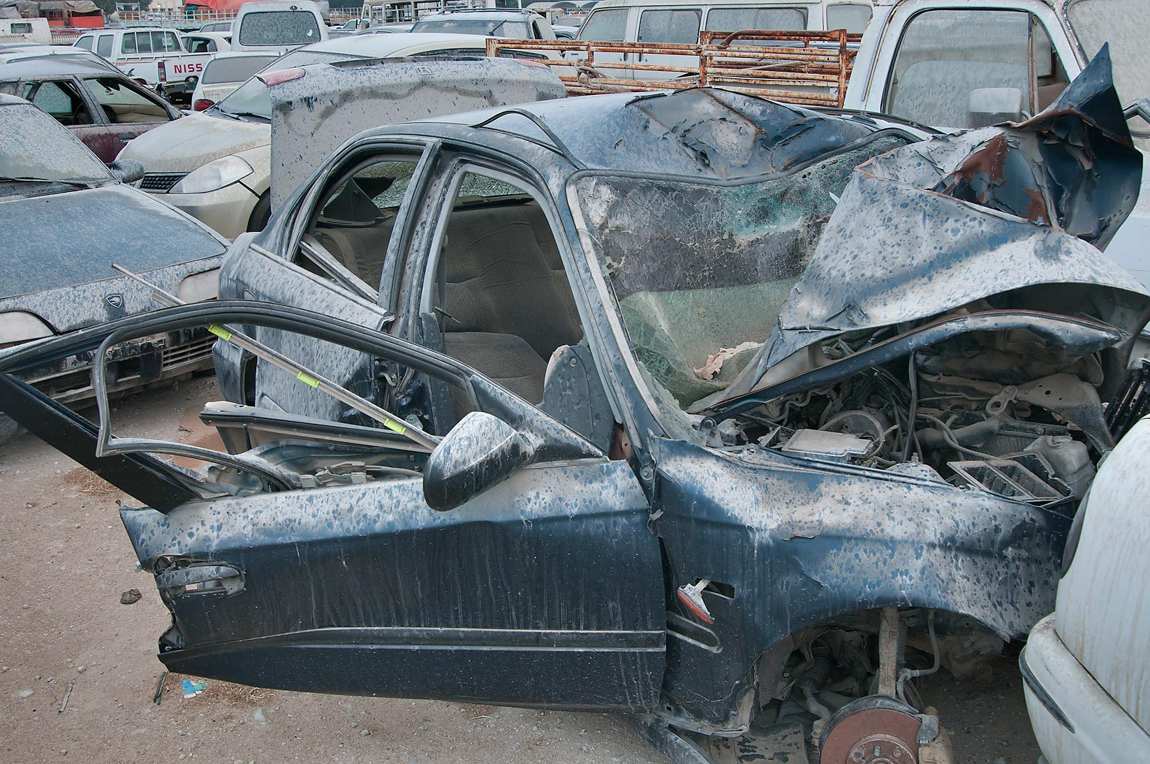 Dusty junk cars near Al Mamoura Traffic Police...in Wholesale Markets area. Doha, Qatar