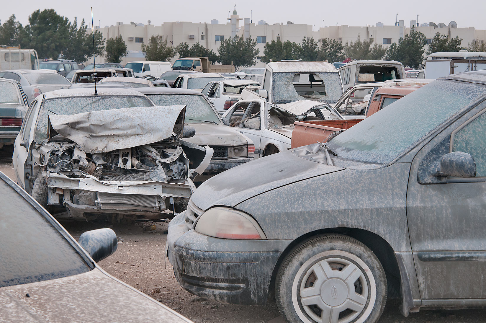 Dusty crashed cars near Al Mamoura Traffic Police...in Wholesale Markets area. Doha, Qatar
