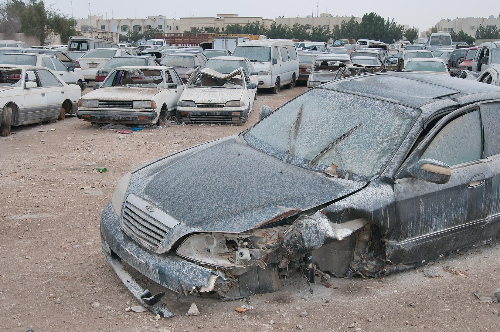 Dusty cars near Al Mamoura Traffic Police and...in Wholesale Markets area. Doha, Qatar