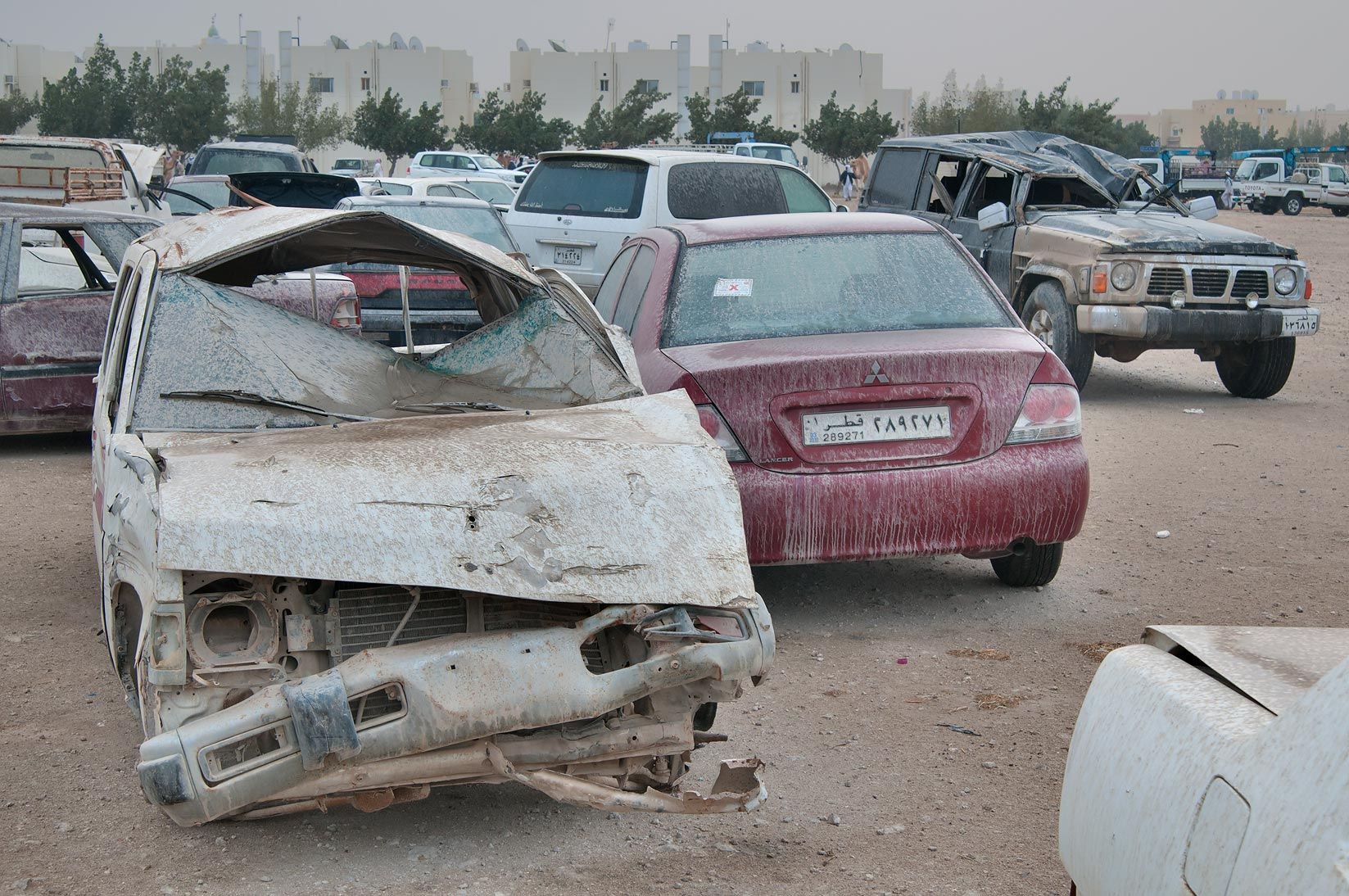 Dusty deformed cars near Al Mamoura Traffic...in Wholesale Markets area. Doha, Qatar