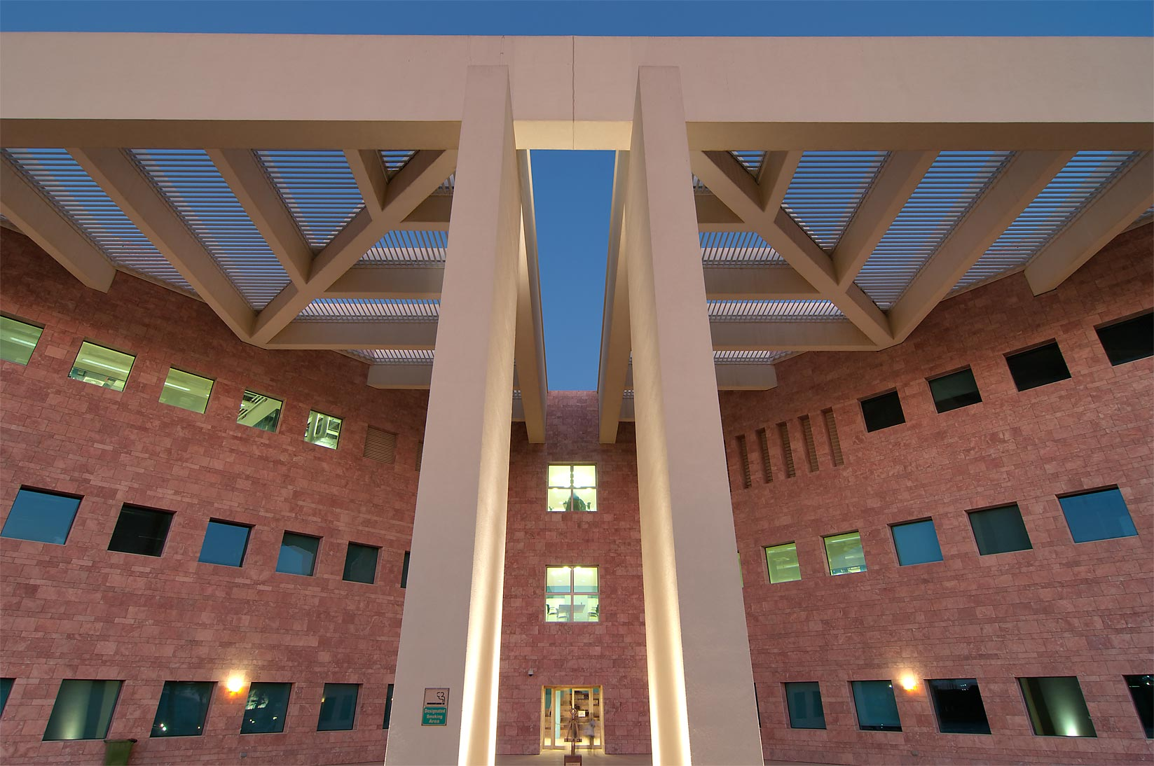 Beam structure at west entrance of TAMUQ research...City campus, at evening. Doha, Qatar