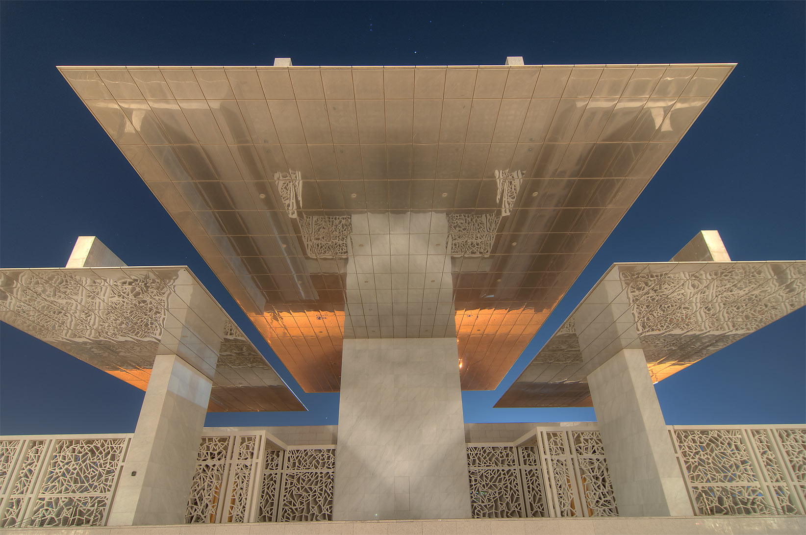 Overhanging steel shade of Ceremonial Court in...City campus, at evening. Doha, Qatar