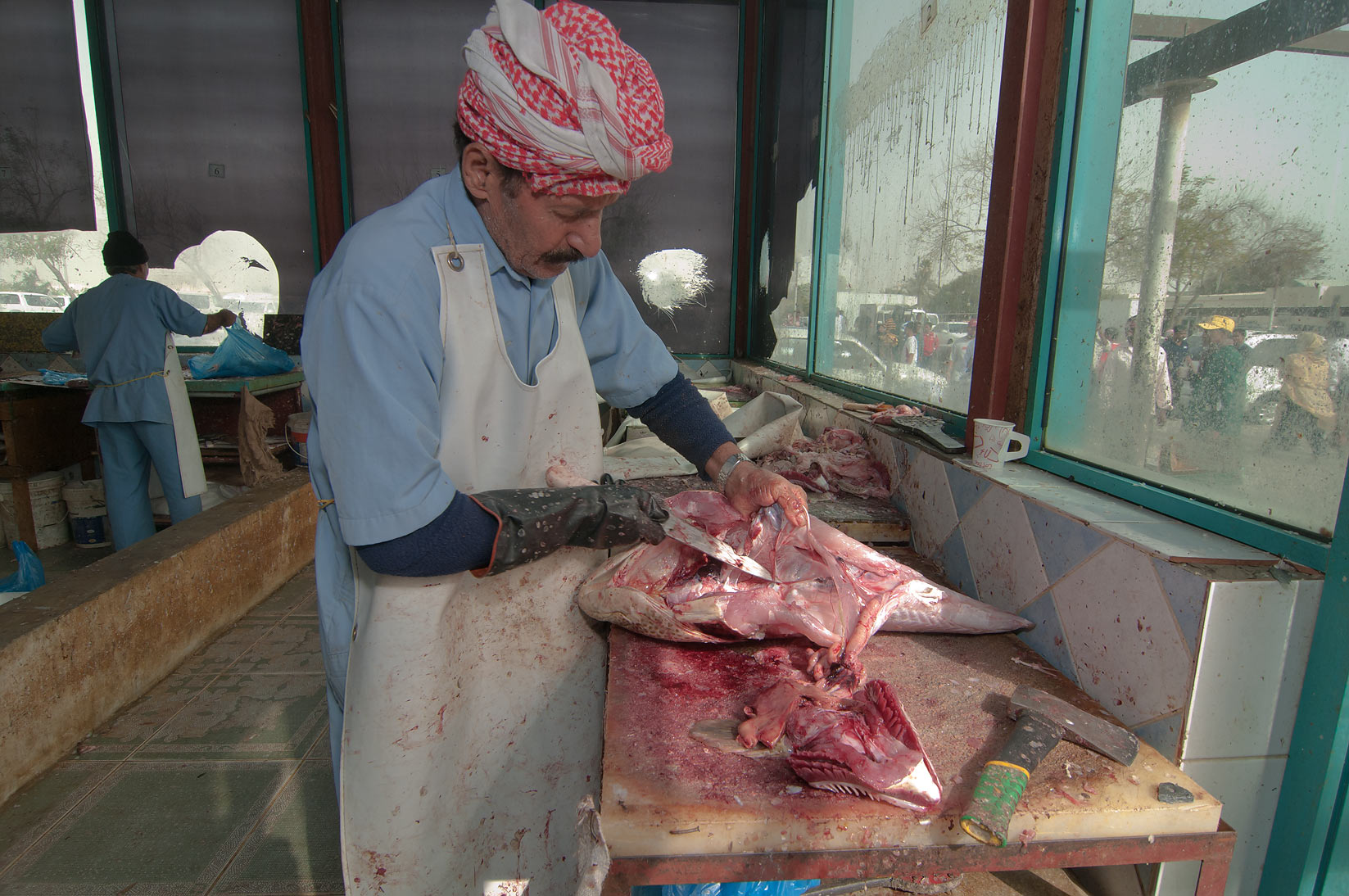 Fish gutting in Wholesale Fish Market. Doha, Qatar