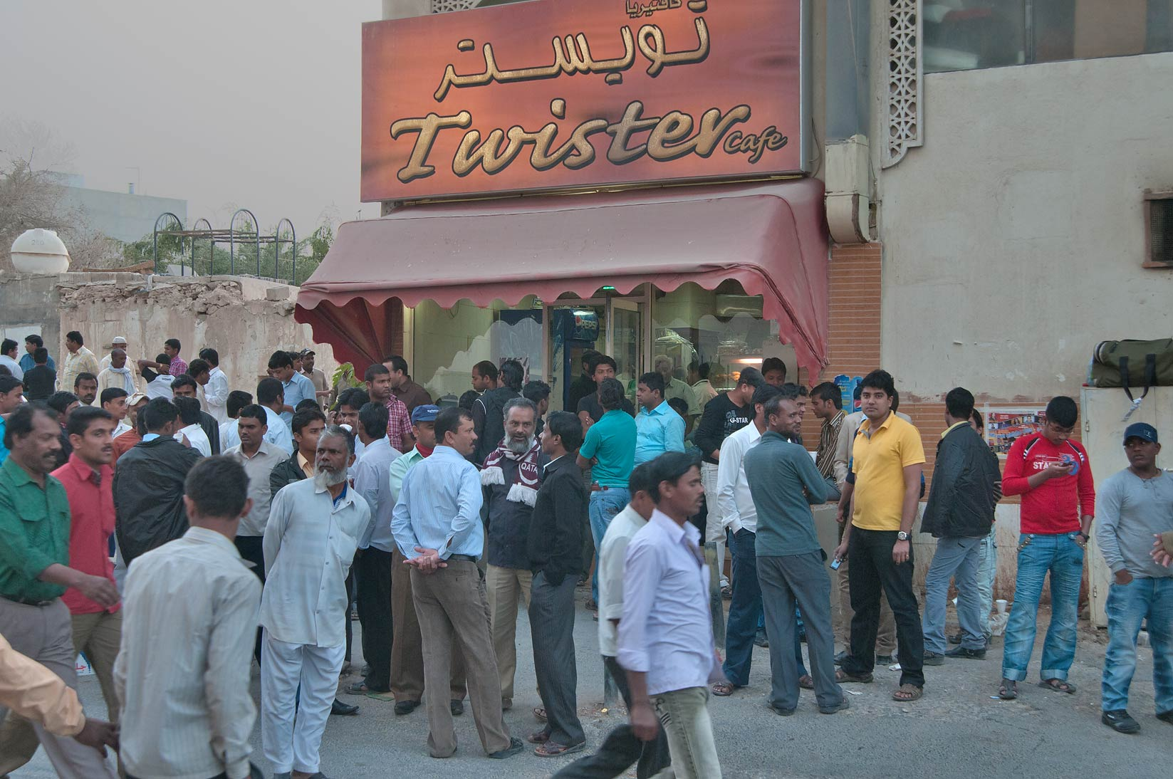 Gathering near Twister Cafe in Al Najada Souq on Friday evening. Doha, Qatar