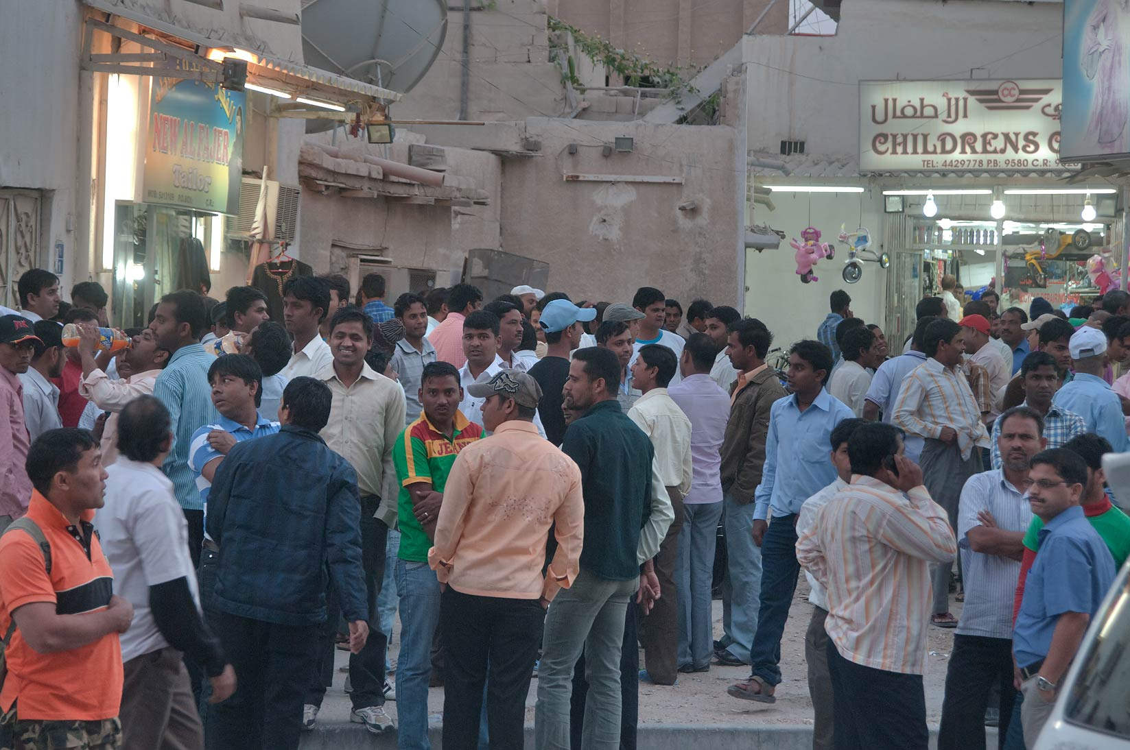 Workers gathering at Al Najada Souq on Friday evening. Doha, Qatar