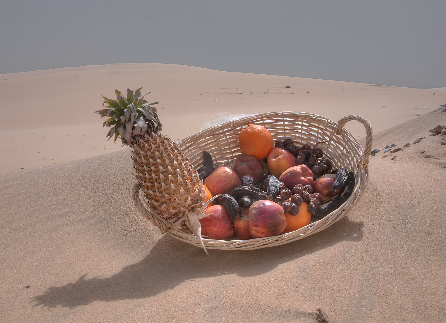 Remains of a lunch left on Singing Sand Dunes near Mesaieed. Qatar