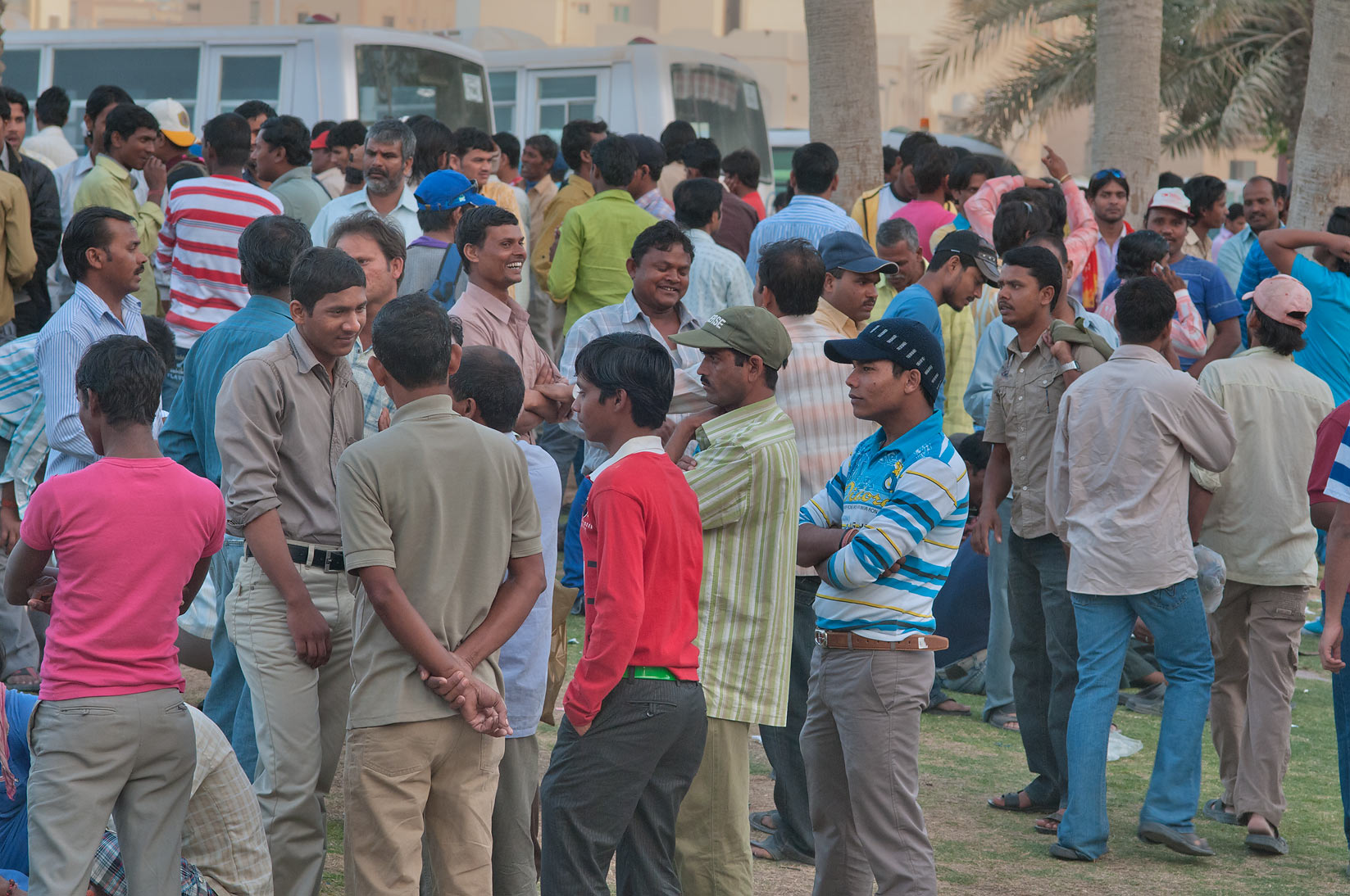 Migrant workers crowding near Central Bus Station Al Ghanim on Friday. Doha, Qatar