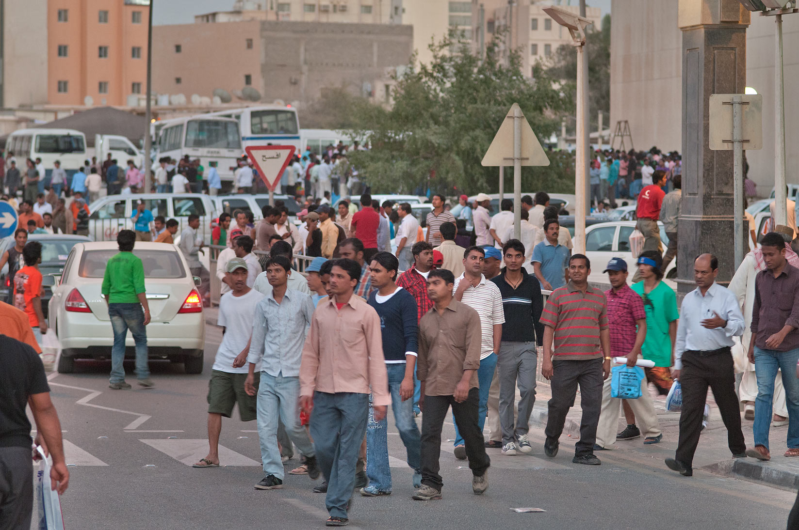 Friday evening crowds near Central Bus Station in area of Souq Najada. Doha, Qatar