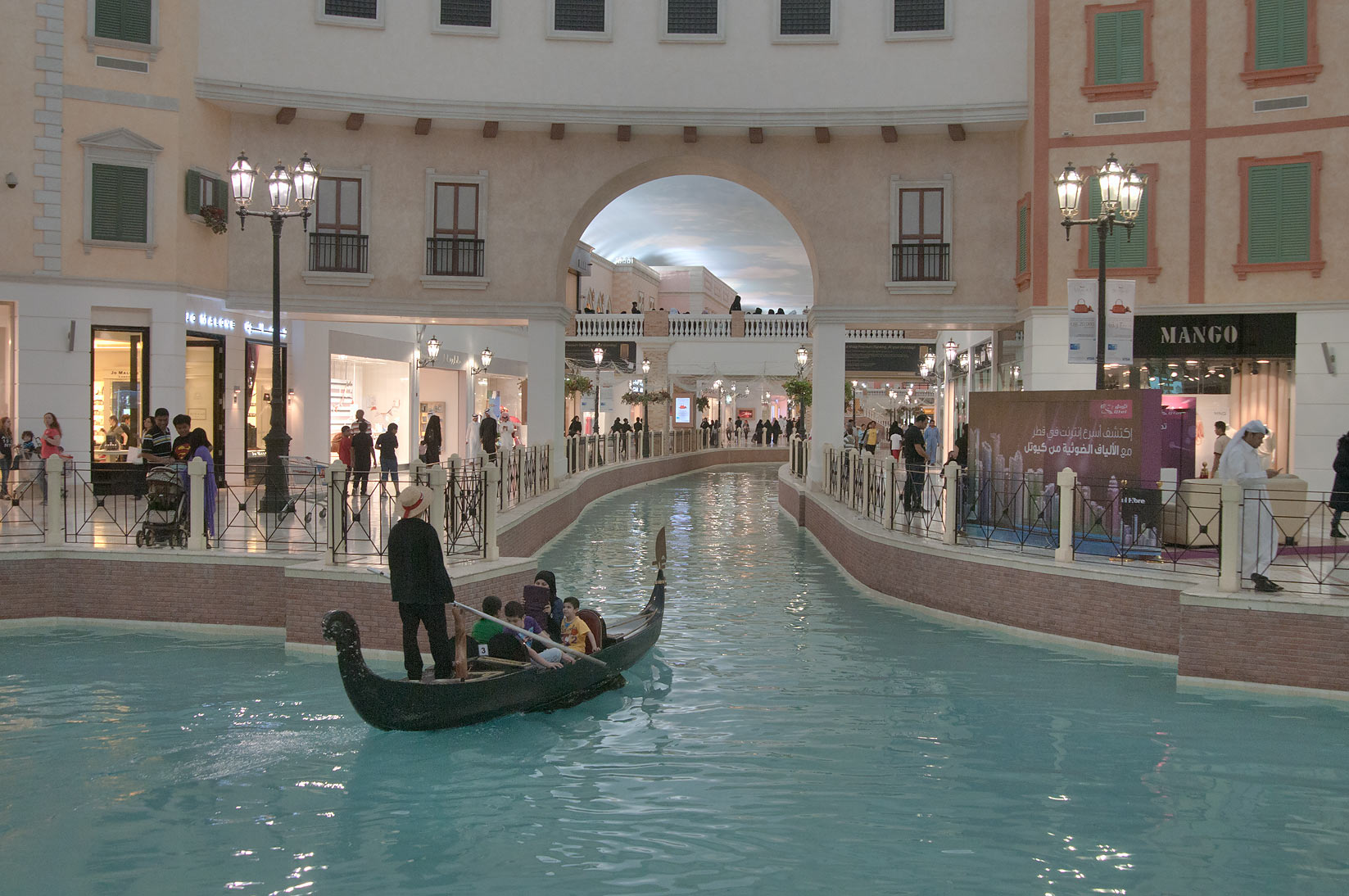 Gondola boat floating in a canal in Villagio Shopping Mall, Aspire Zone. Doha, Qatar
