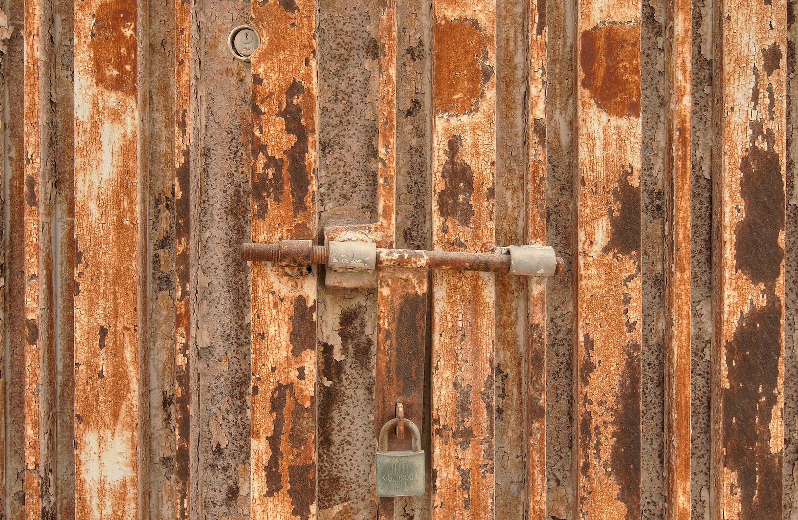 Rusty door in Abu Hamour District, north from Wholesale Markets area. Doha, Qatar