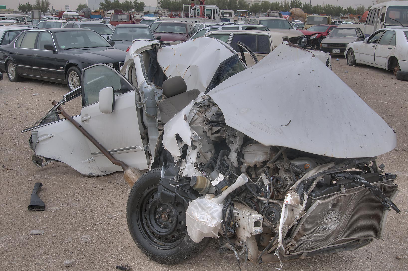Deformed silver car near Al Mamoura Traffic...Wholesale Markets area. Doha, Qatar