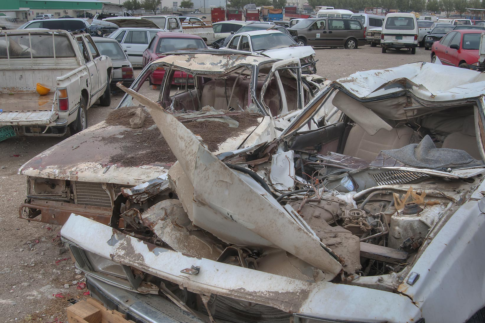 Wrecked cars near Al Mamoura Traffic Police and...Wholesale Markets area. Doha, Qatar