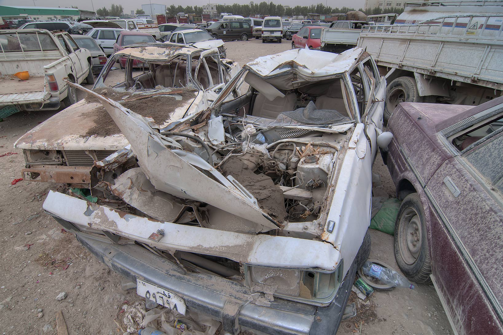 Dusty wrecked cars near Al Mamoura Traffic Police...Wholesale Markets area. Doha, Qatar