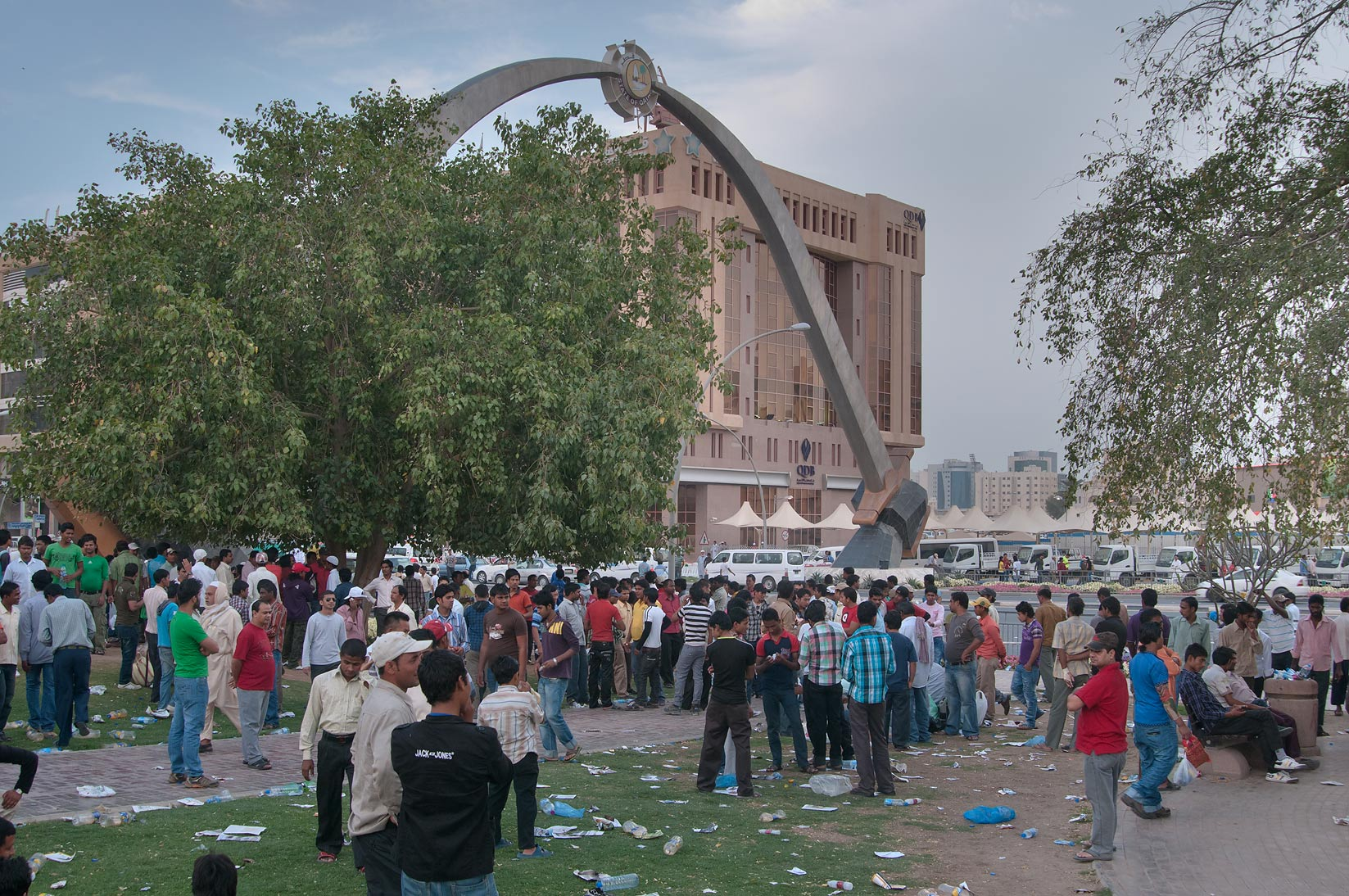 Migrant workers crowding on a lawn at Grand Hamad...Al Ghanim on Friday. Doha, Qatar