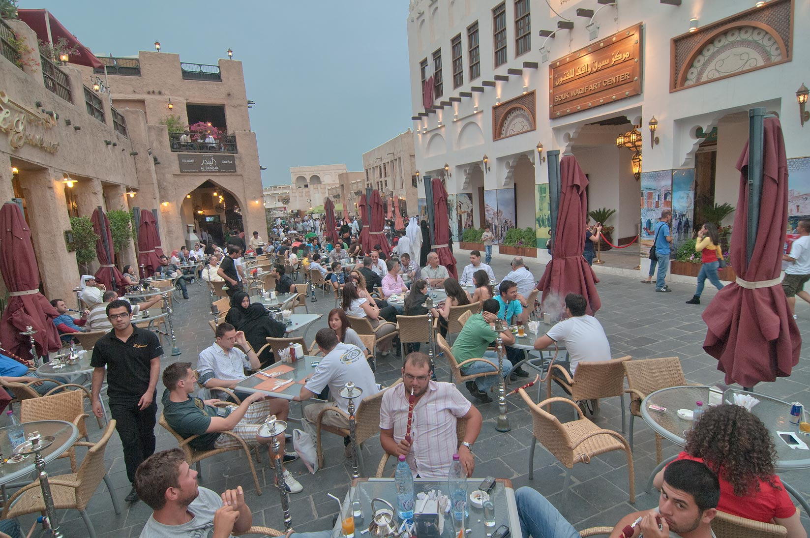 Weekend crowds on Friday evening in Souq Waqif (Old Market). Doha, Qatar