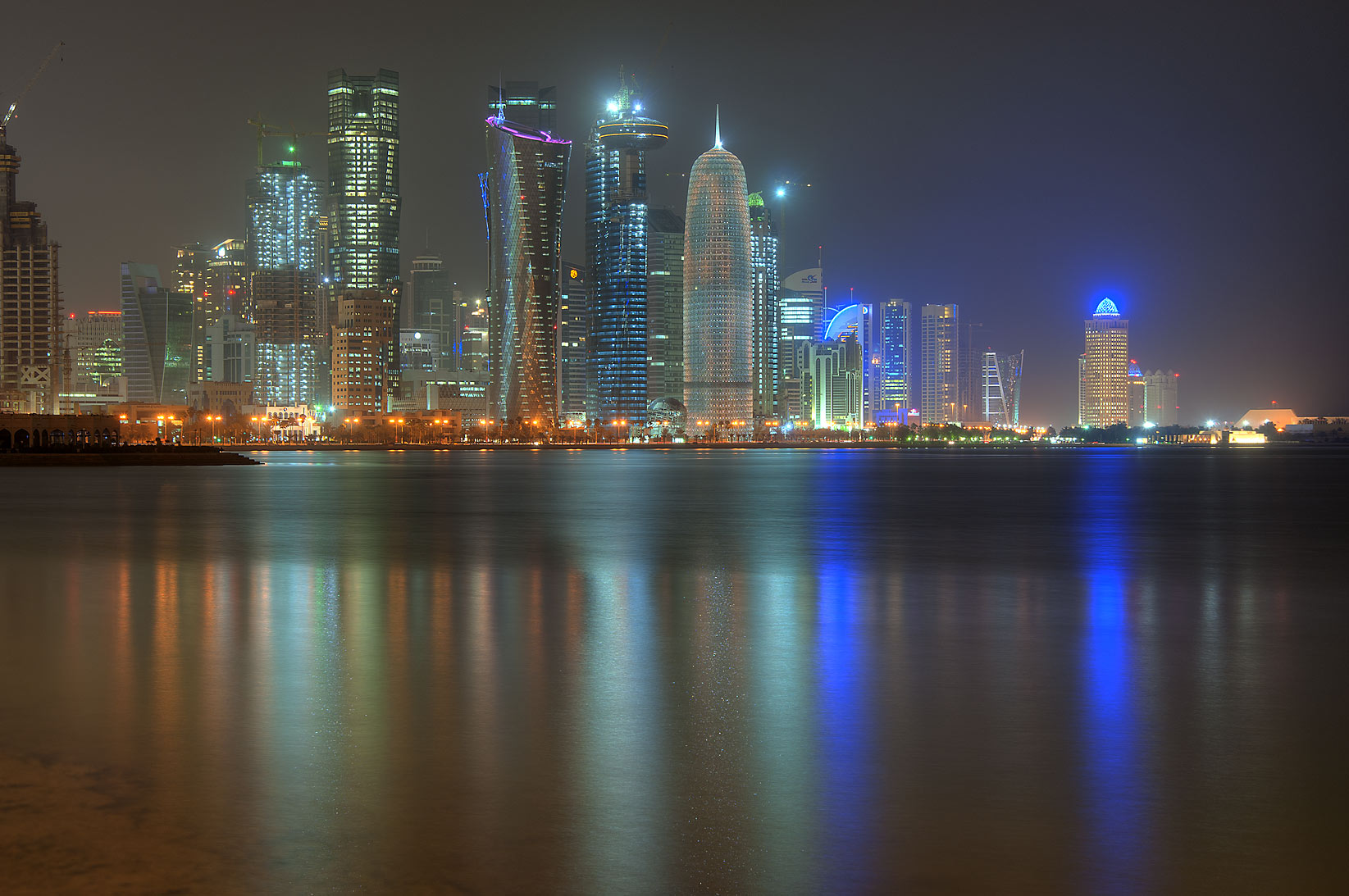 West Bay lights from Corniche opposite to Al Bidda Park at night. Doha, Qatar