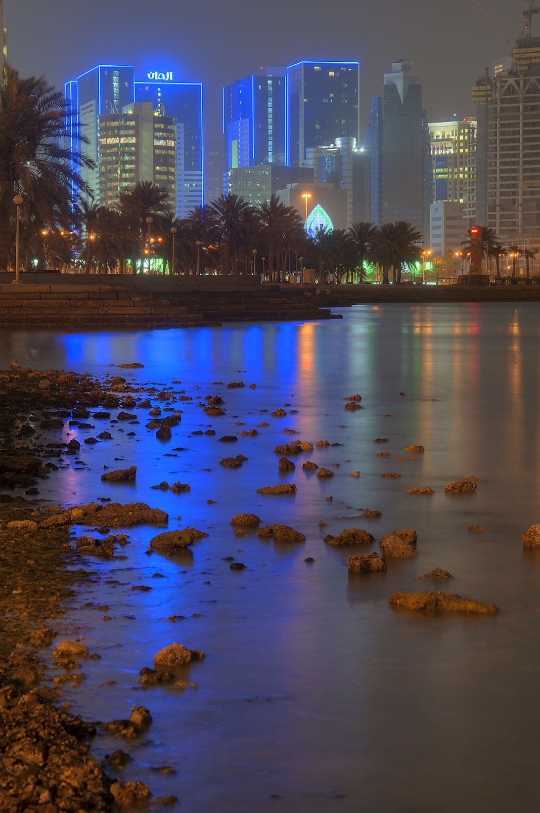 Reflections of bright blue lights of Ezdan Hotel...opposite to Al Bidda Park. Doha, Qatar