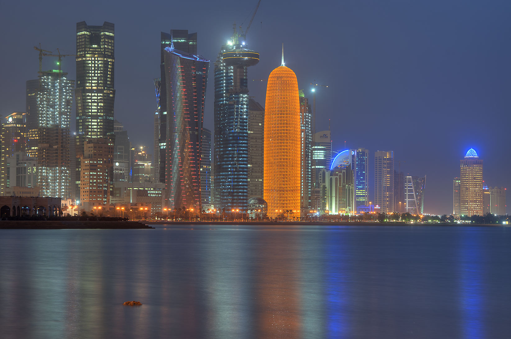 West Bay reflections from Corniche opposite to Al Bidda Park at morning dusk. Doha, Qatar