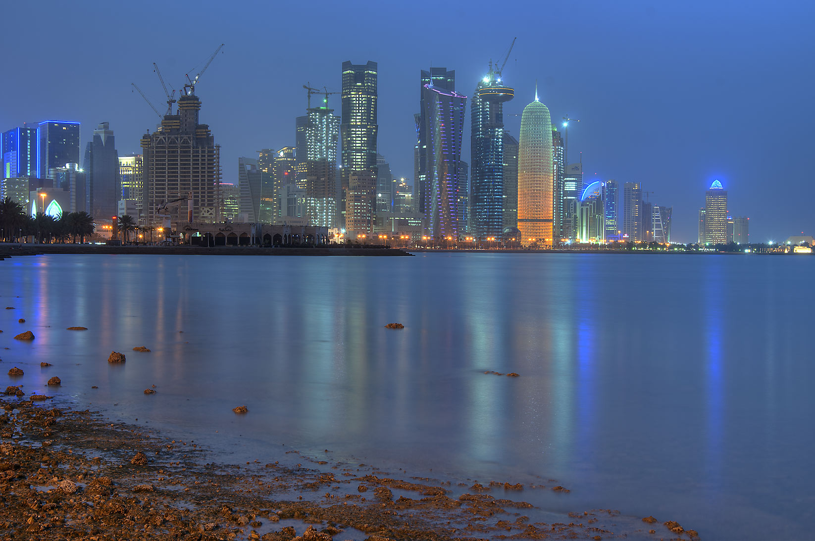 West Bay skyscrapers from Corniche opposite to Al Bidda Park at morning. Doha, Qatar