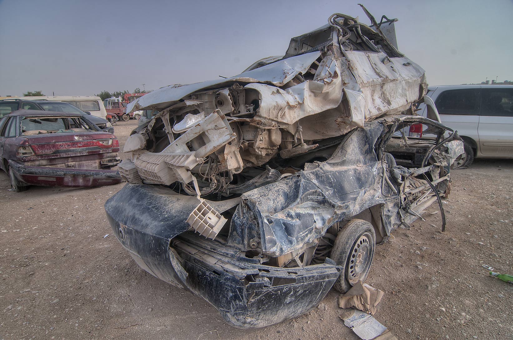 Stacked damaged cars near Al Mamoura Traffic...Wholesale Markets area. Doha, Qatar