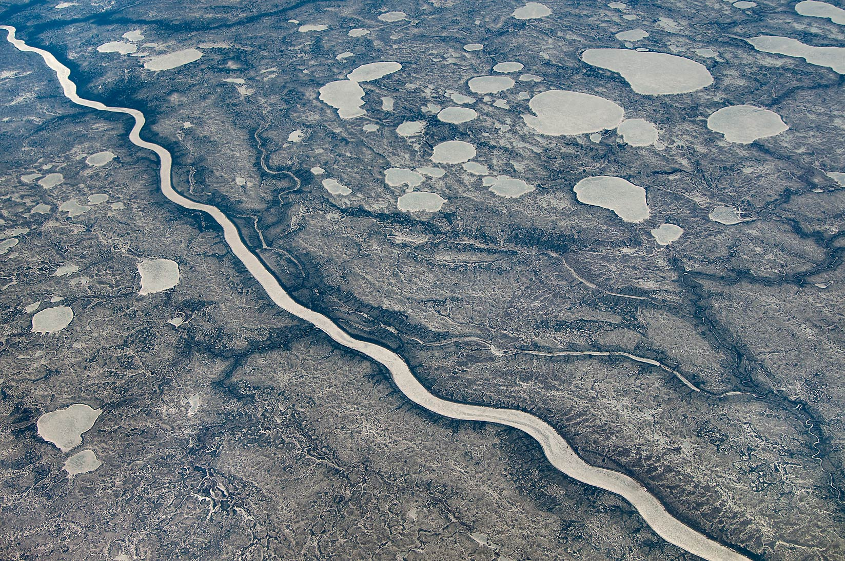 Arctic river in Canada from a window of a plane from Doha, Qatar to Houston, Texas
