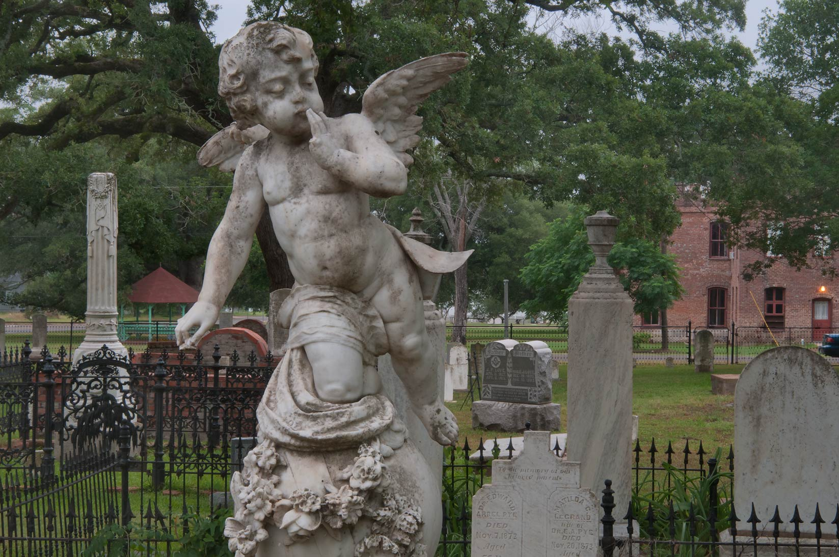 Marble angel on a tomb of Holly Robert in Calvert Cemetery. Calvert, Texas