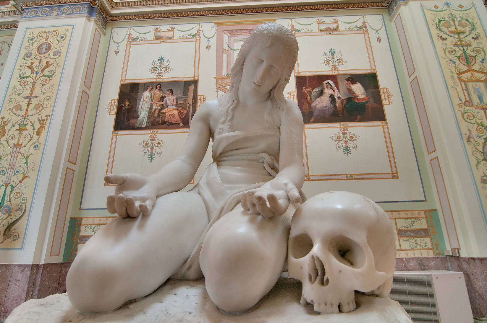 Marble statue of a woman with a skull in a...Museum. St.Petersburg, Russia