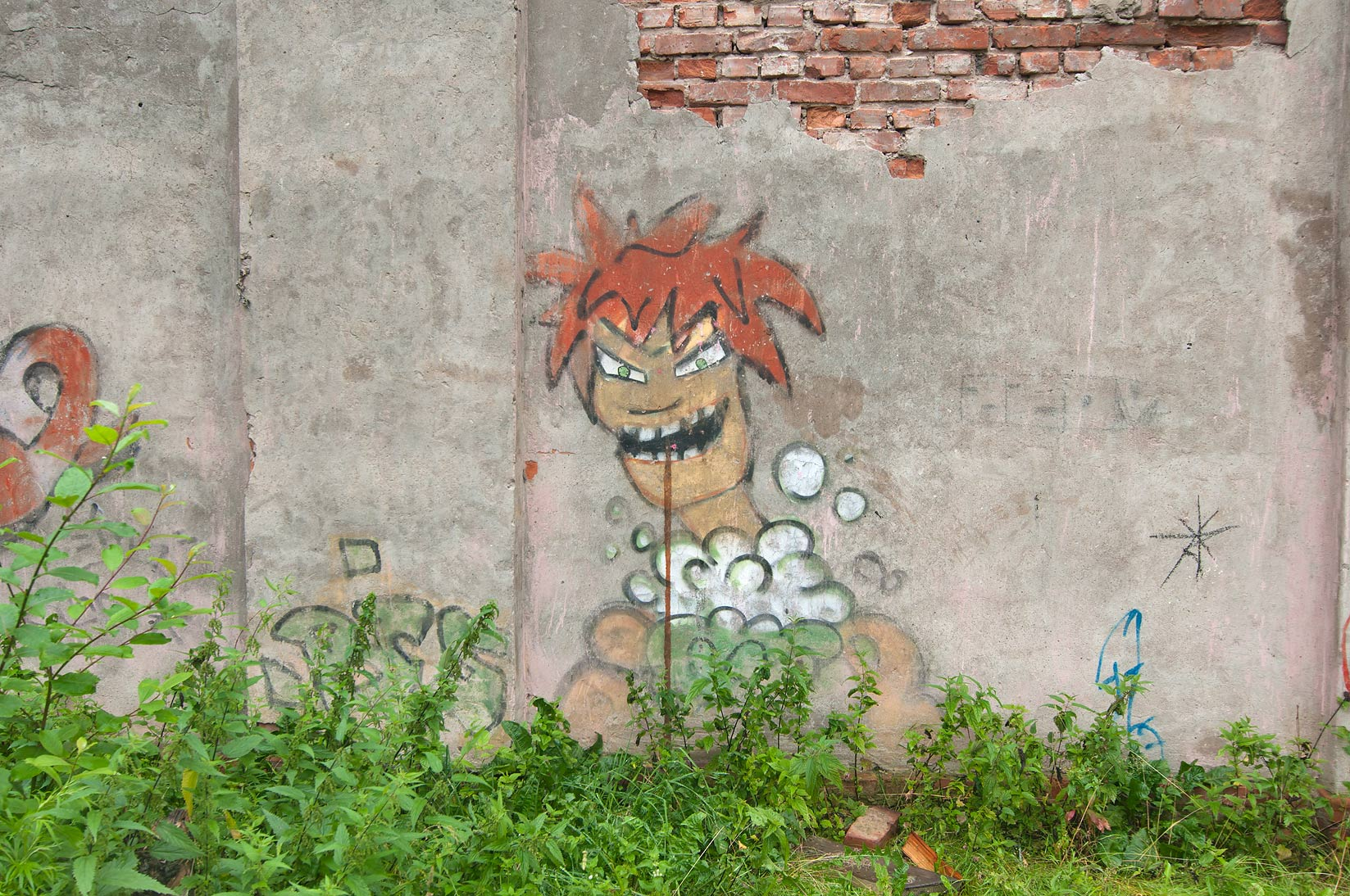 Graffiti near children's playground near...in Kronstadt. St.Petersburg, Russia