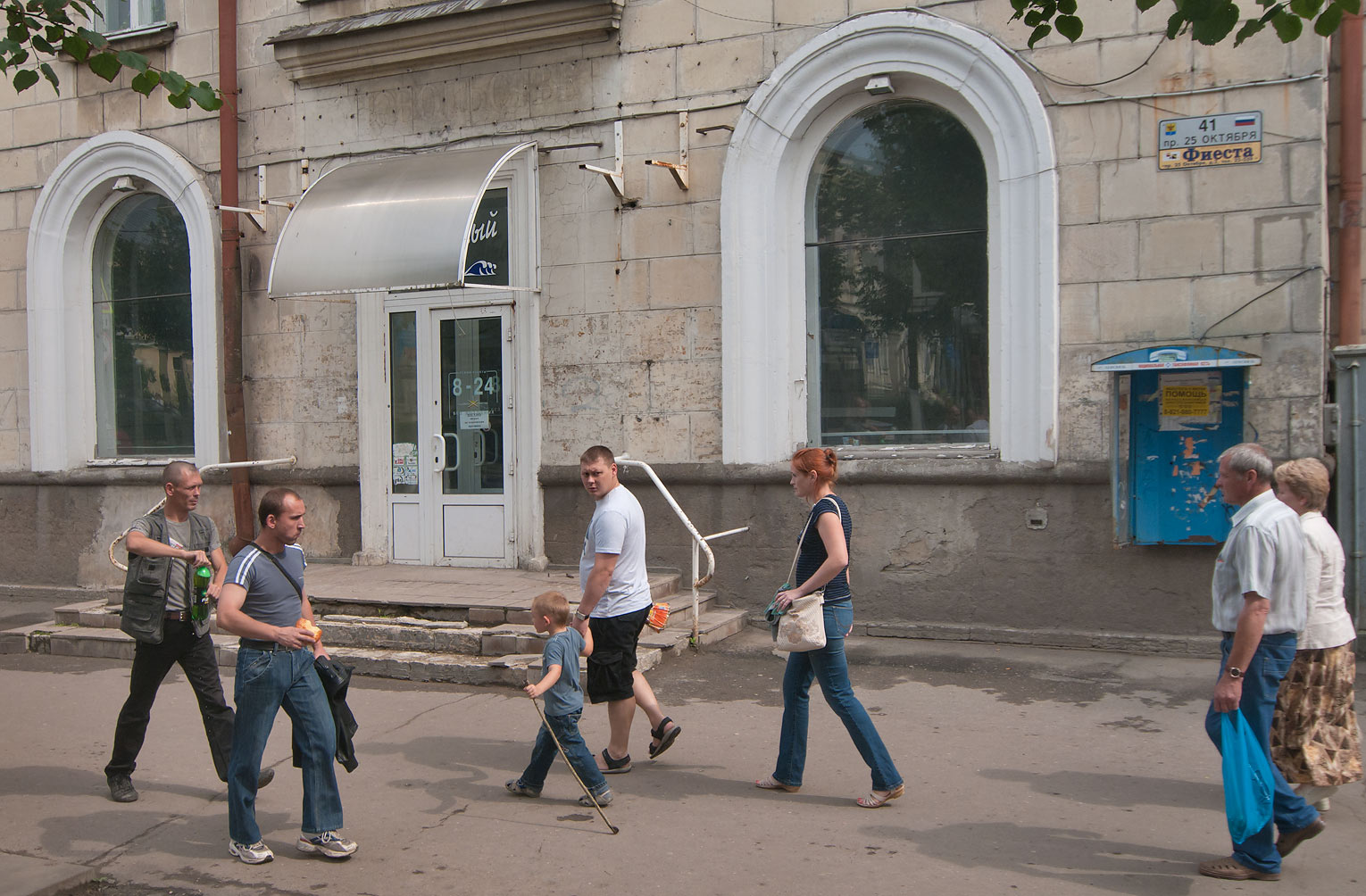 Pedestrians on 25 Oktiabria St., view from a...a suburb of St.Petersburg, Russia
