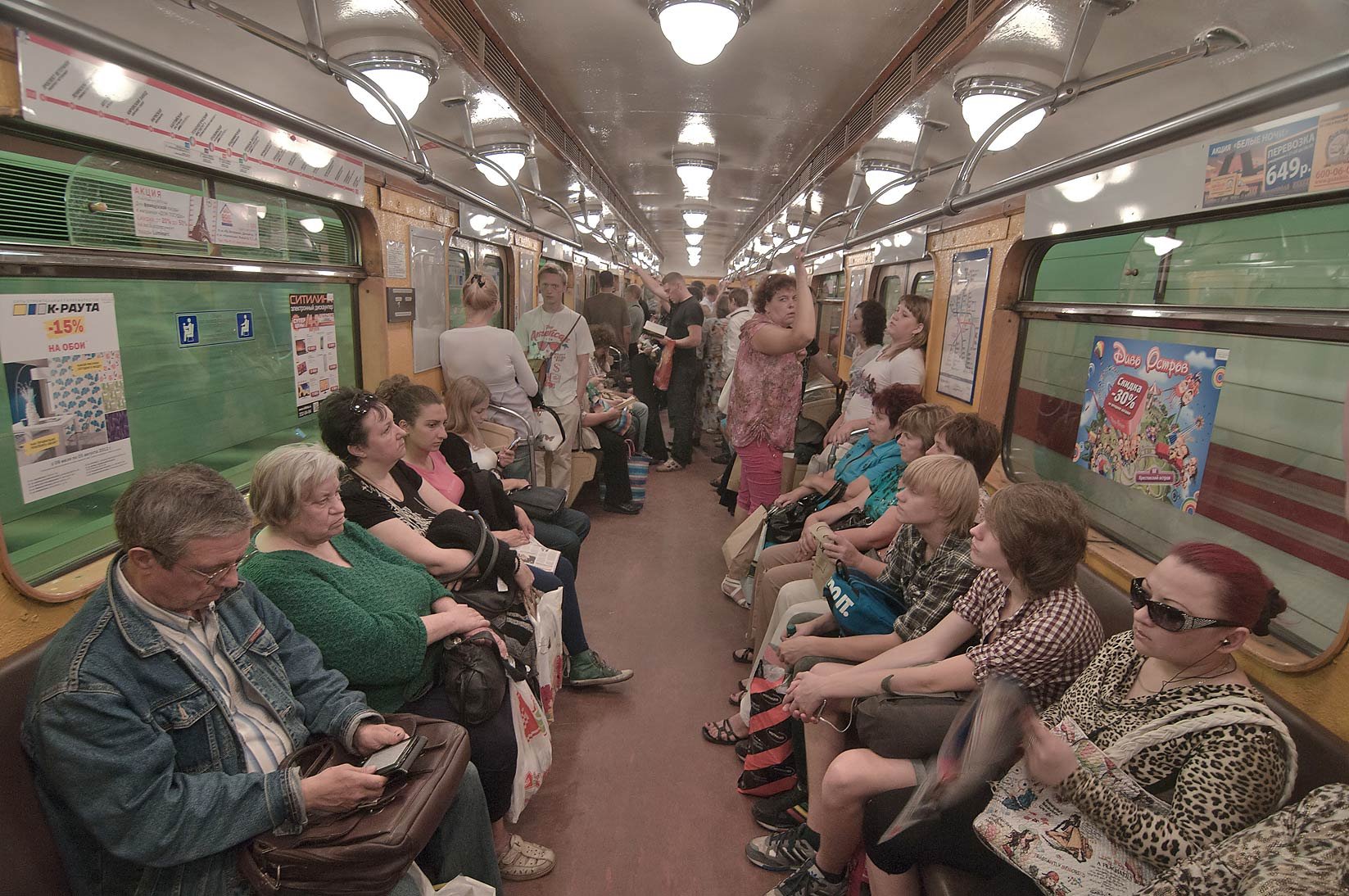 Passengers sitting in Metro (subway) train. St.Petersburg, Russia