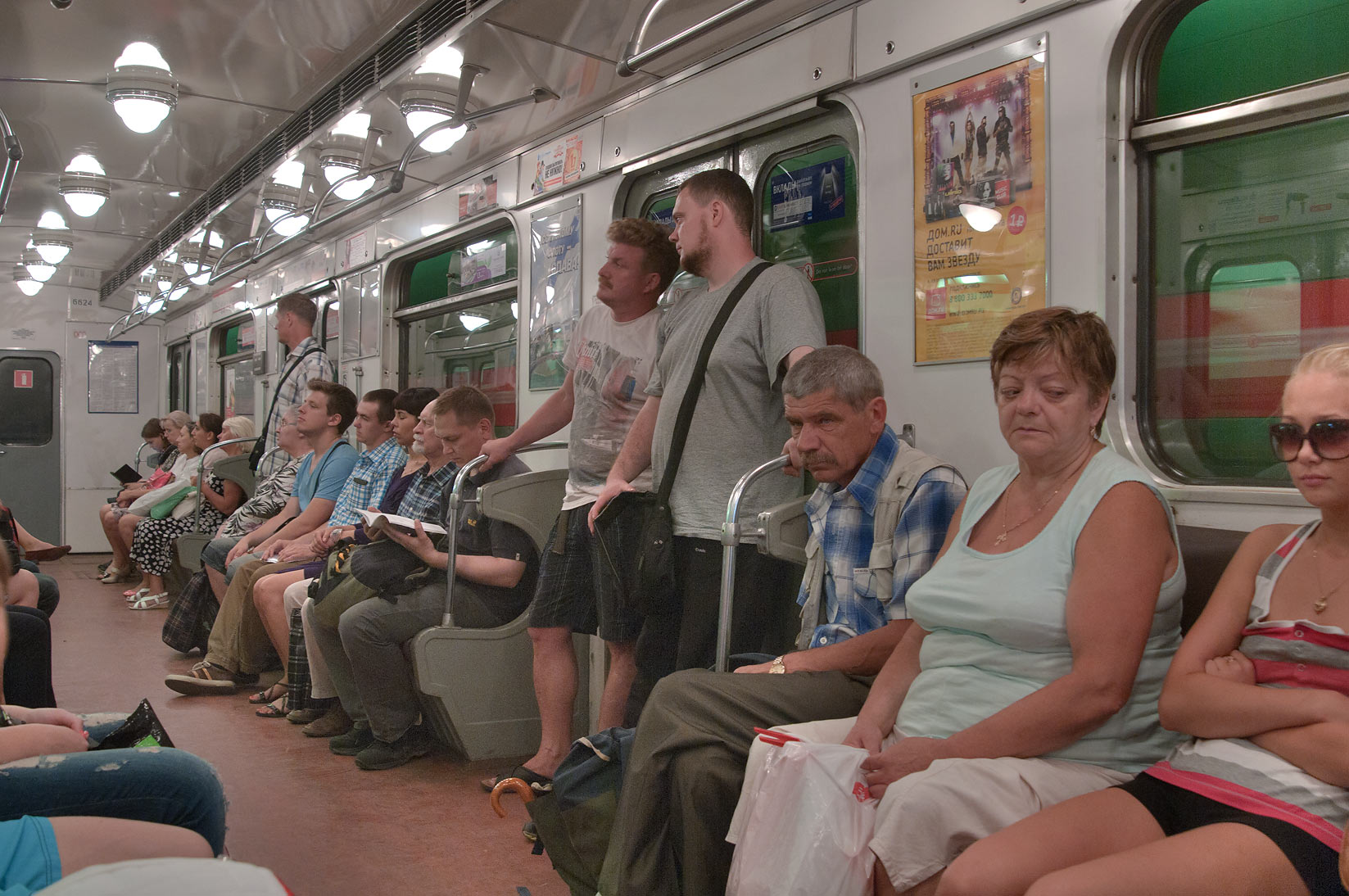 Passengers sitting in a carriage of Metro (subway). St.Petersburg, Russia