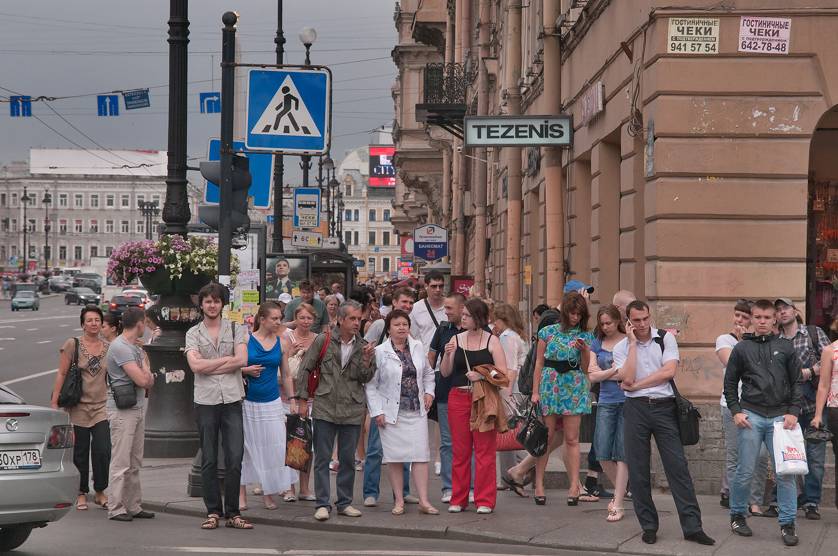 Pedestrians on Nevsky Prospect at Marata St. crossing. St.Petersburg, Russia