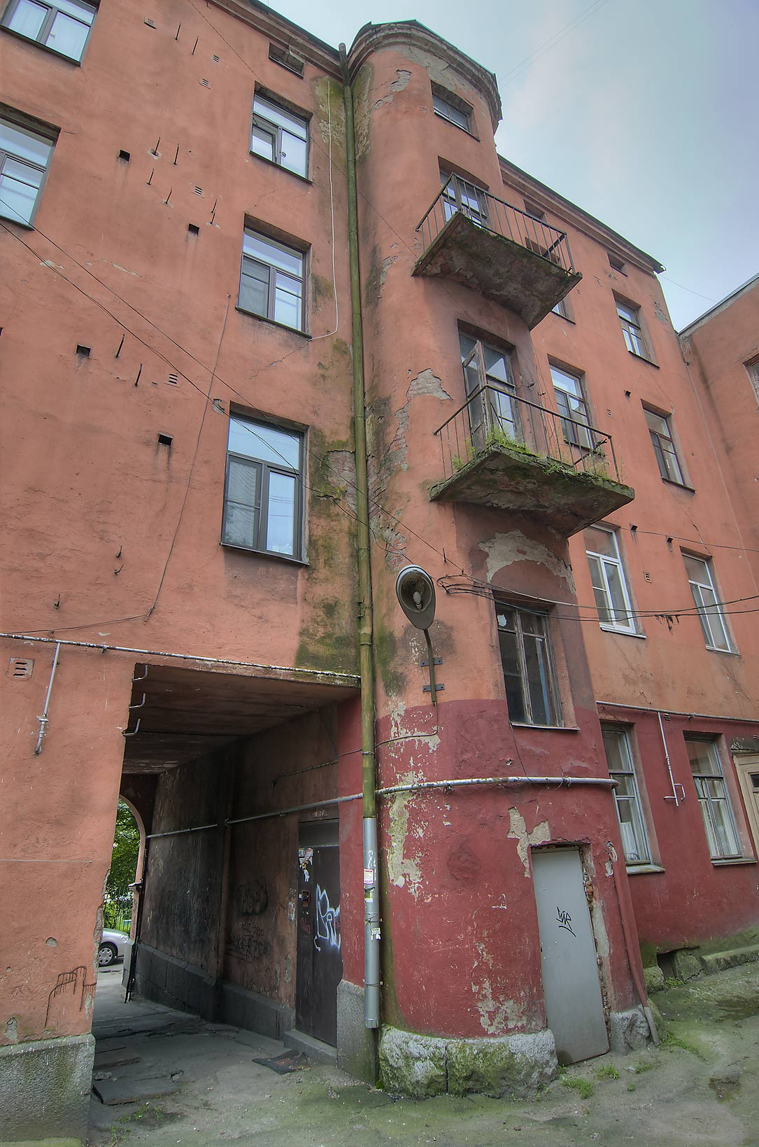 Red plaster house on Titova St.. Vyborg, Russia