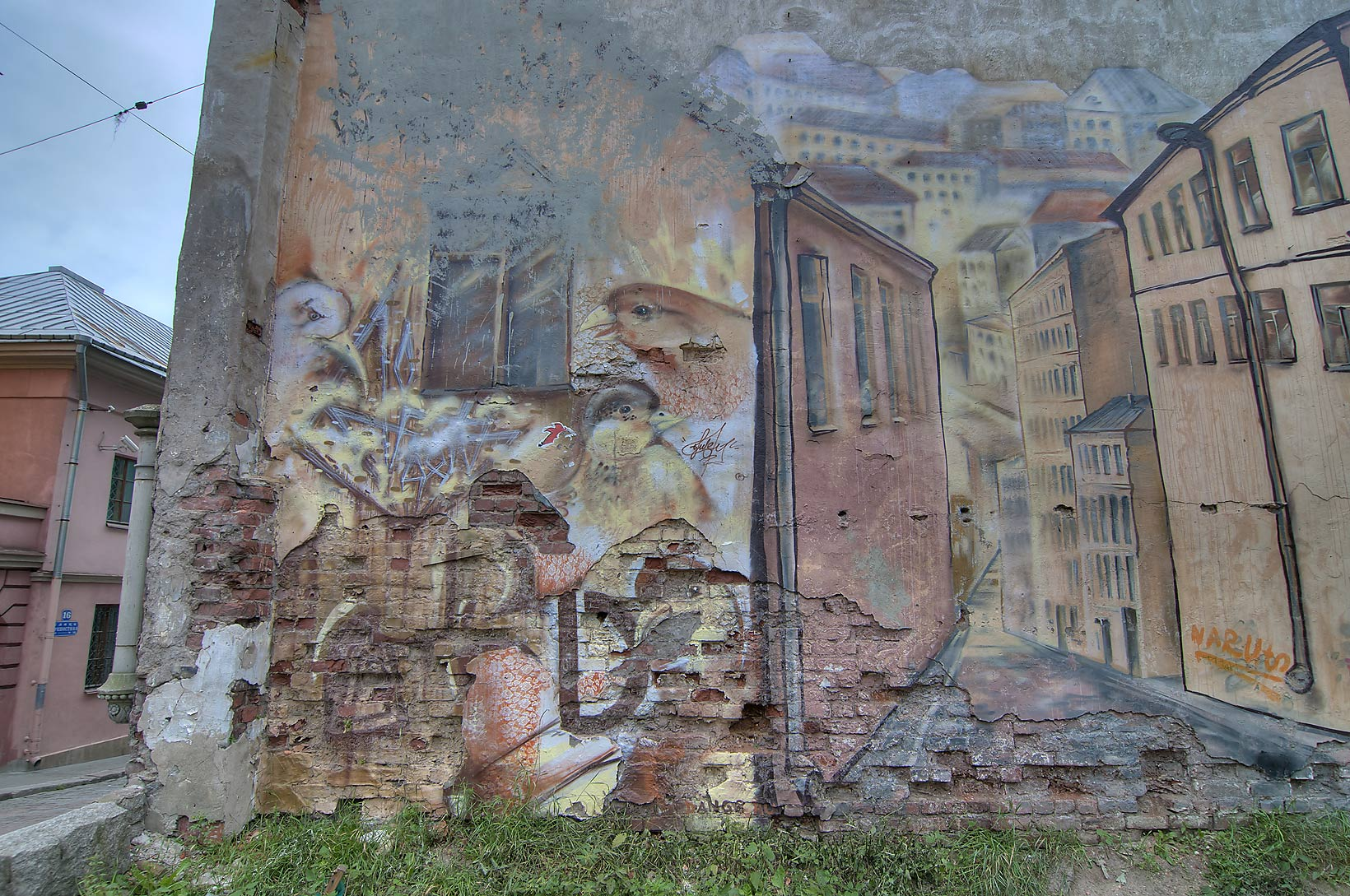 Graffiti art on walls of Goving House at 11 Krepostnaya St.. Vyborg, Russia