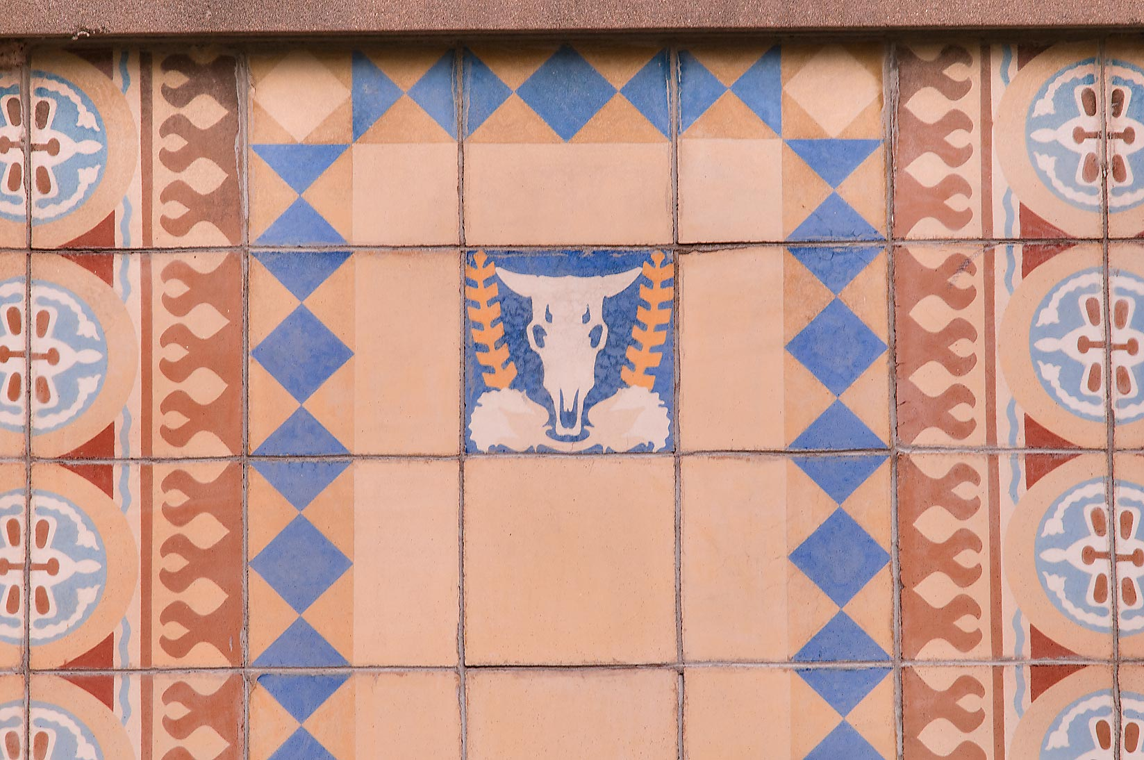 Cow skulls among ceramic tile ornamentation on...M University. College Station, Texas
