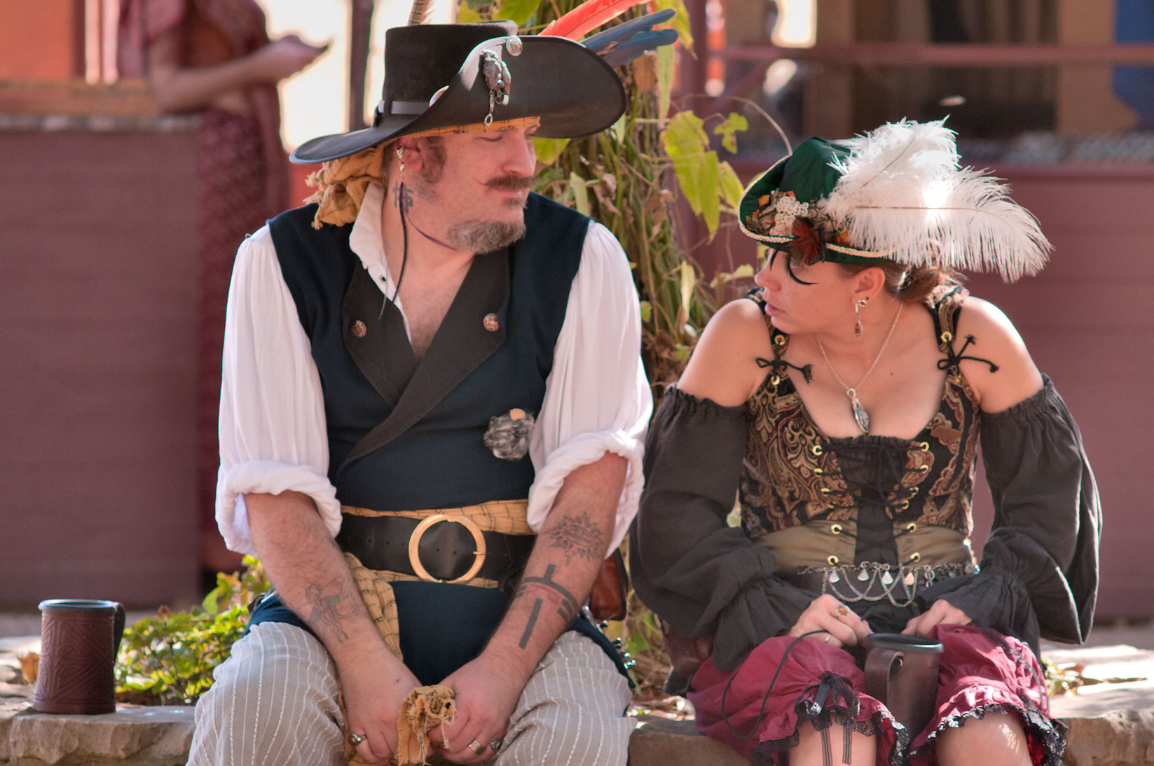 Two costumed visitors at Texas Renaissance Festival. Plantersville, Texas