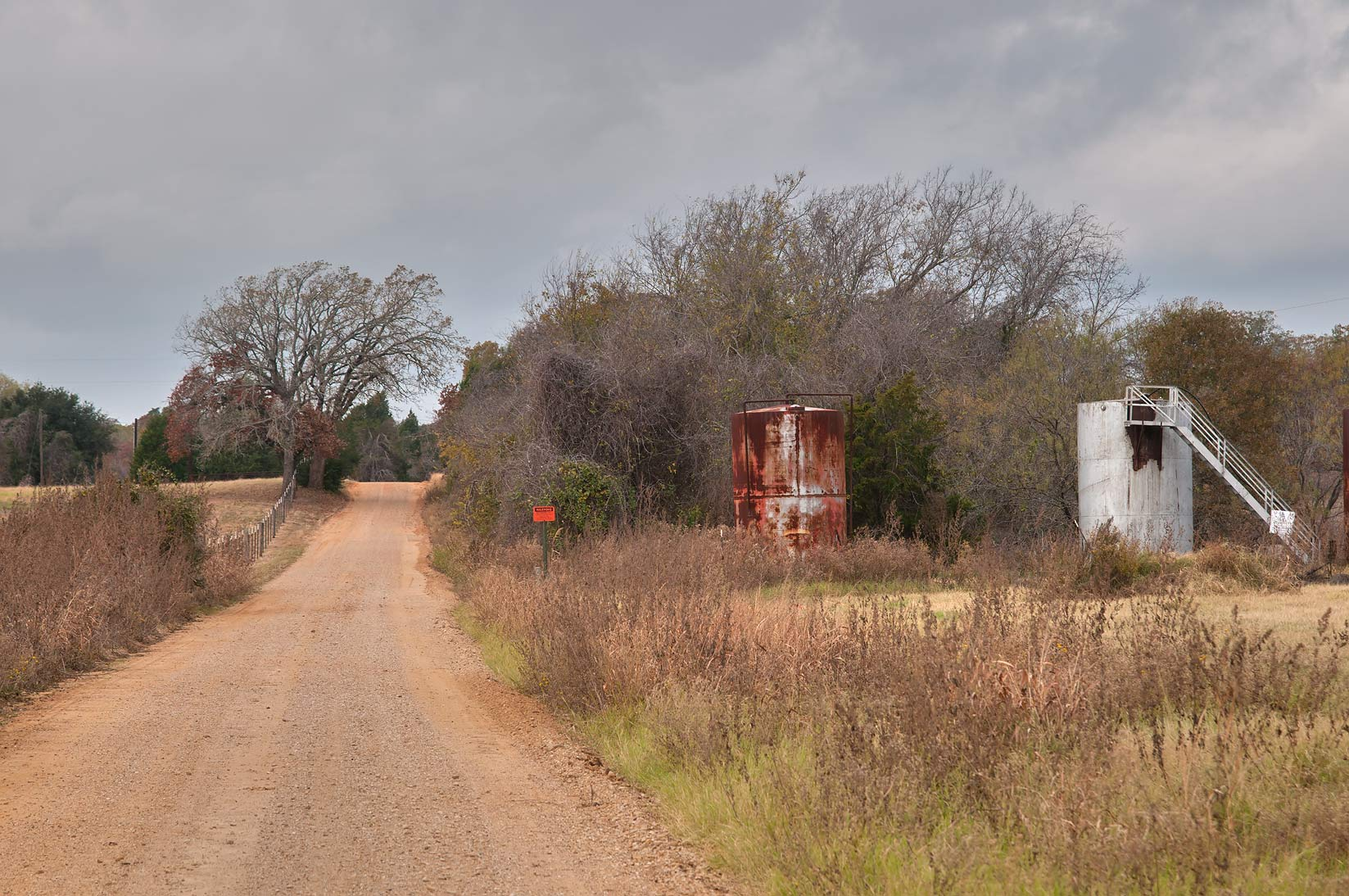 Oil cisterns at Rd. 237 near Cameron. Texas