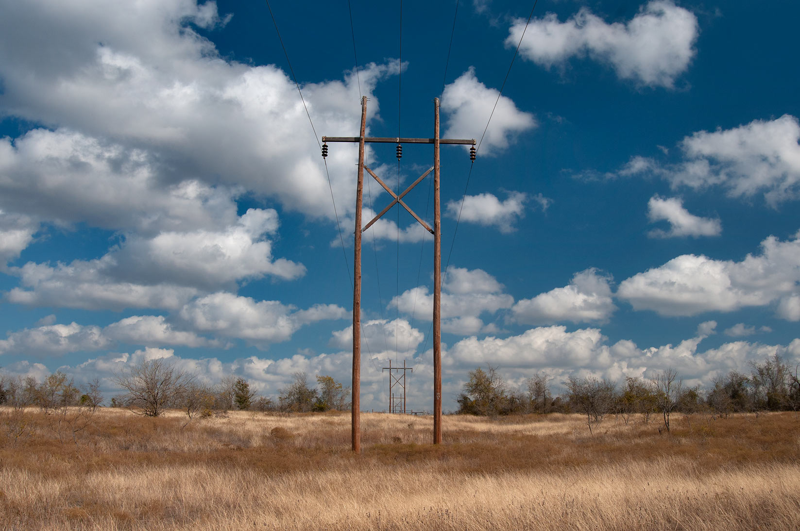 Wooden poles of power lines on a site of Bryant Station near Buckholts. Texas