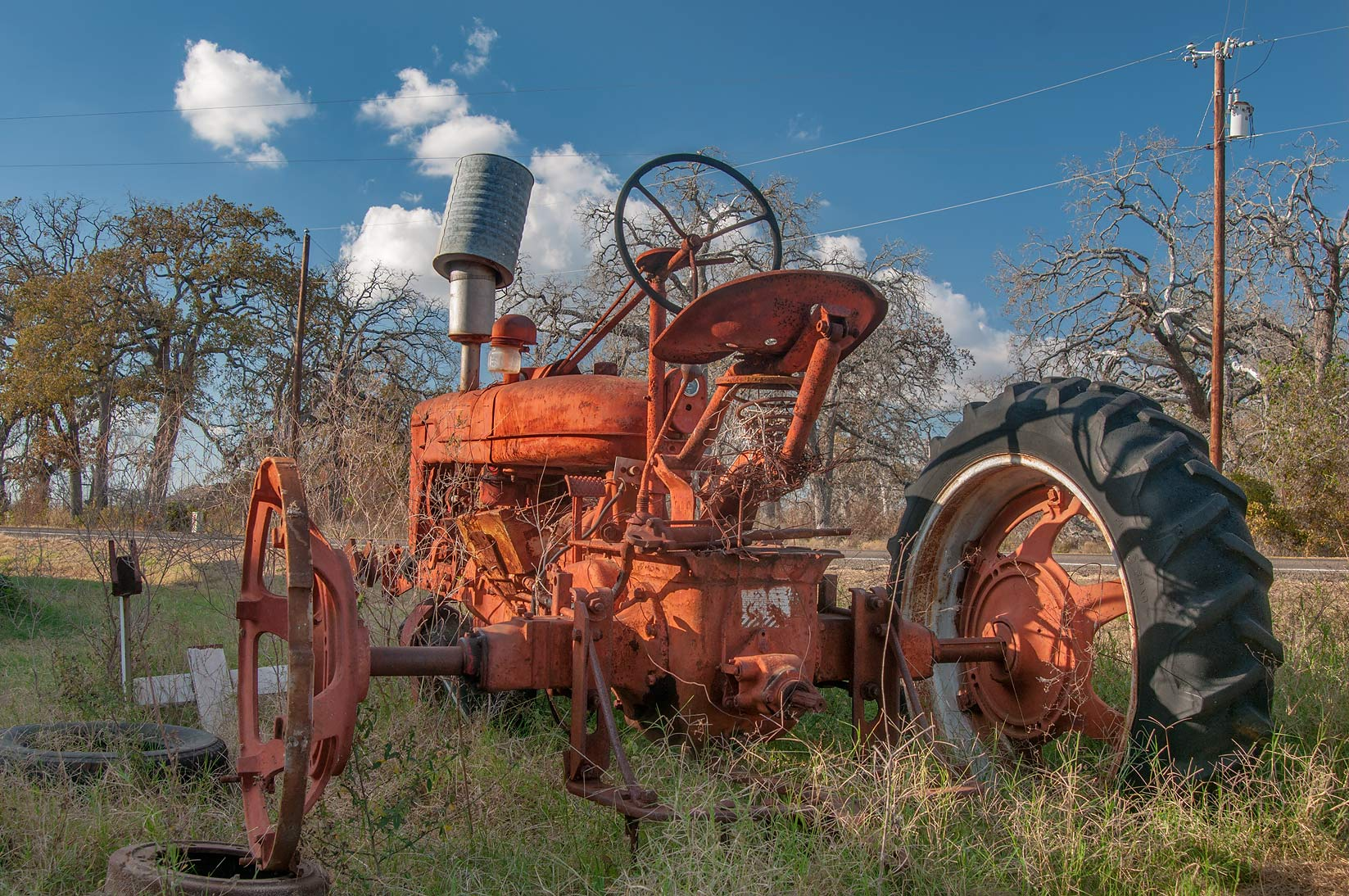 Old tractor in Sharp, view from Rd. FM 487. Texas