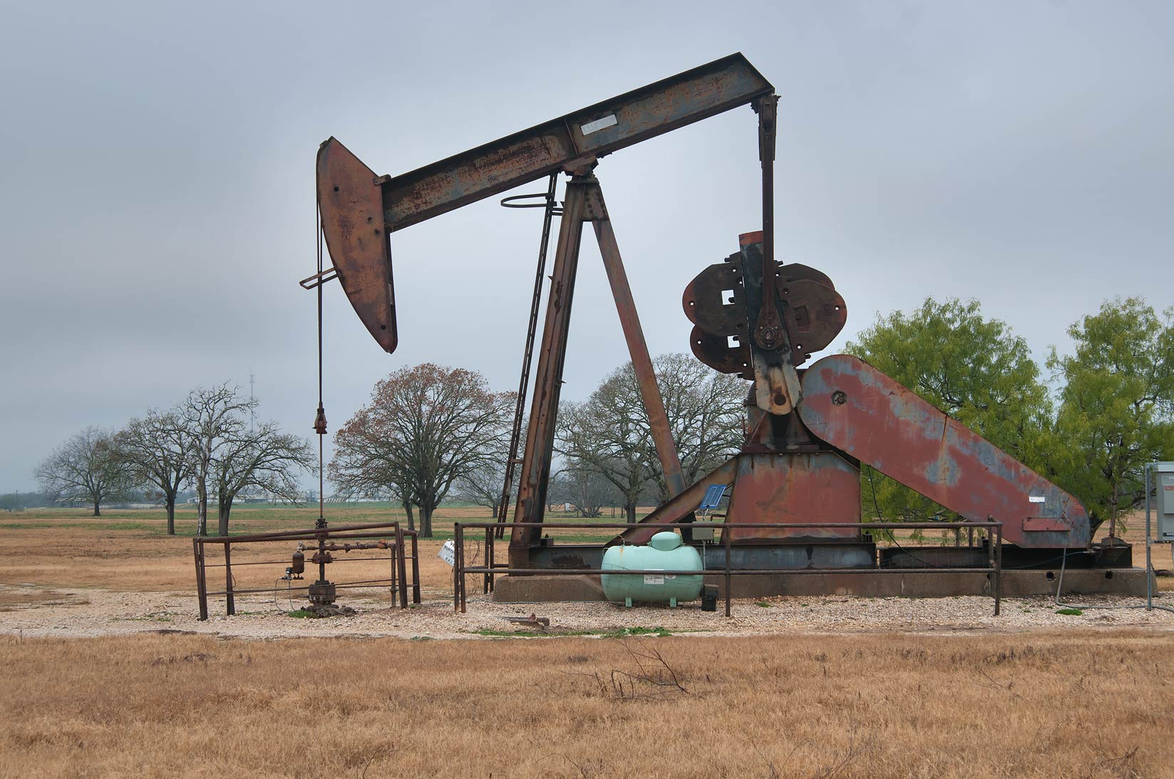 Reciprocating piston pump in an oil well...Democrat Rd., east from Bryan. Texas