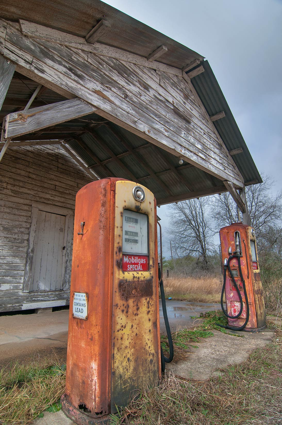 Abandoned Mobil gas pumps of old gas station at...39 S with FM 39 in North Zulch. Texas