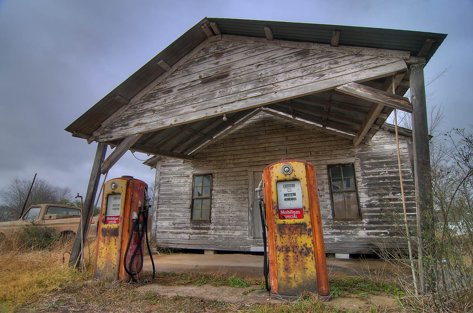 Old gas station with a vintage pickup truck at...39 S with FM 39 in North Zulch. Texas