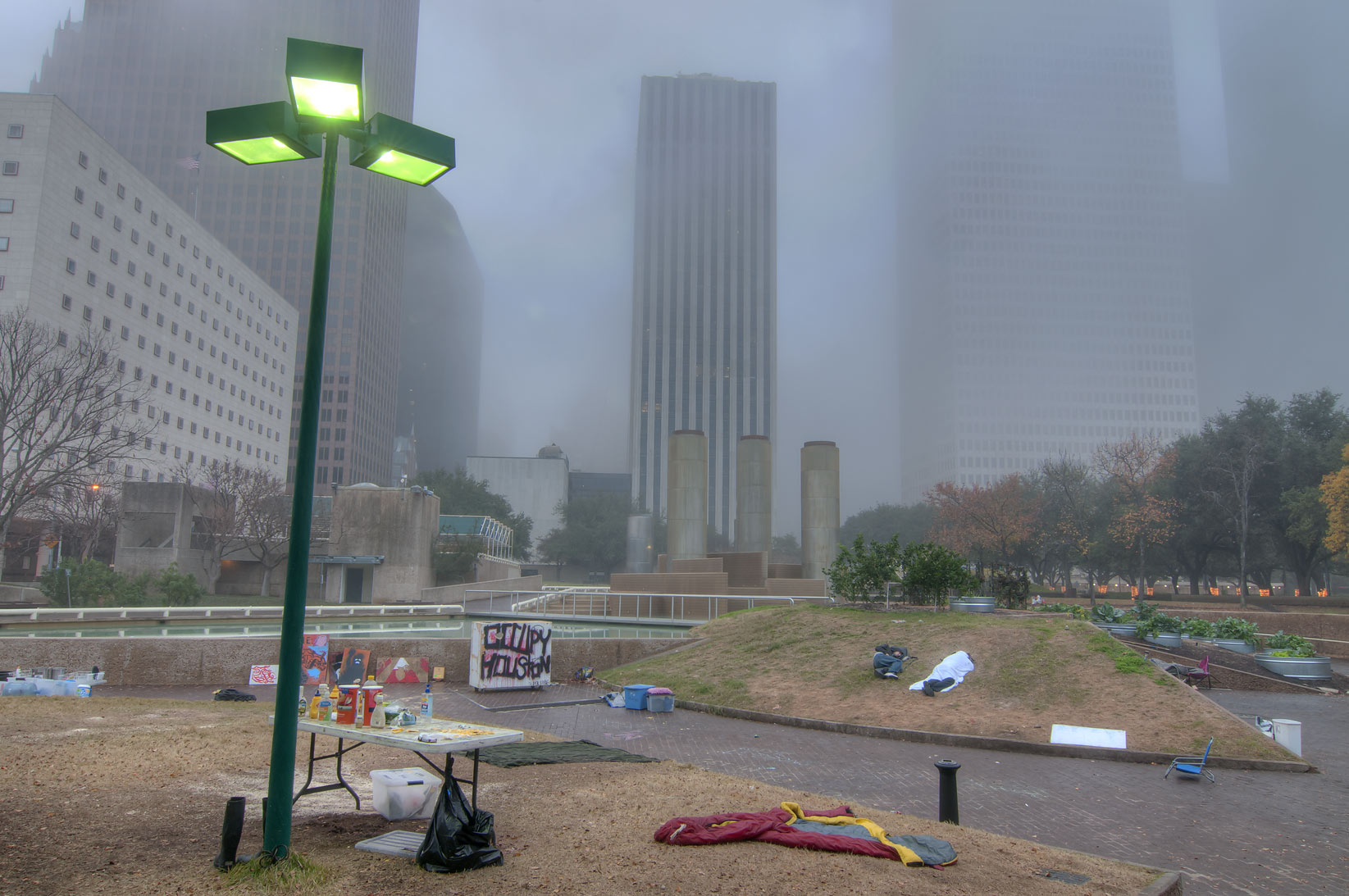 Camping of Occupy Houston in Tranquility Park in fog. Houston, Texas