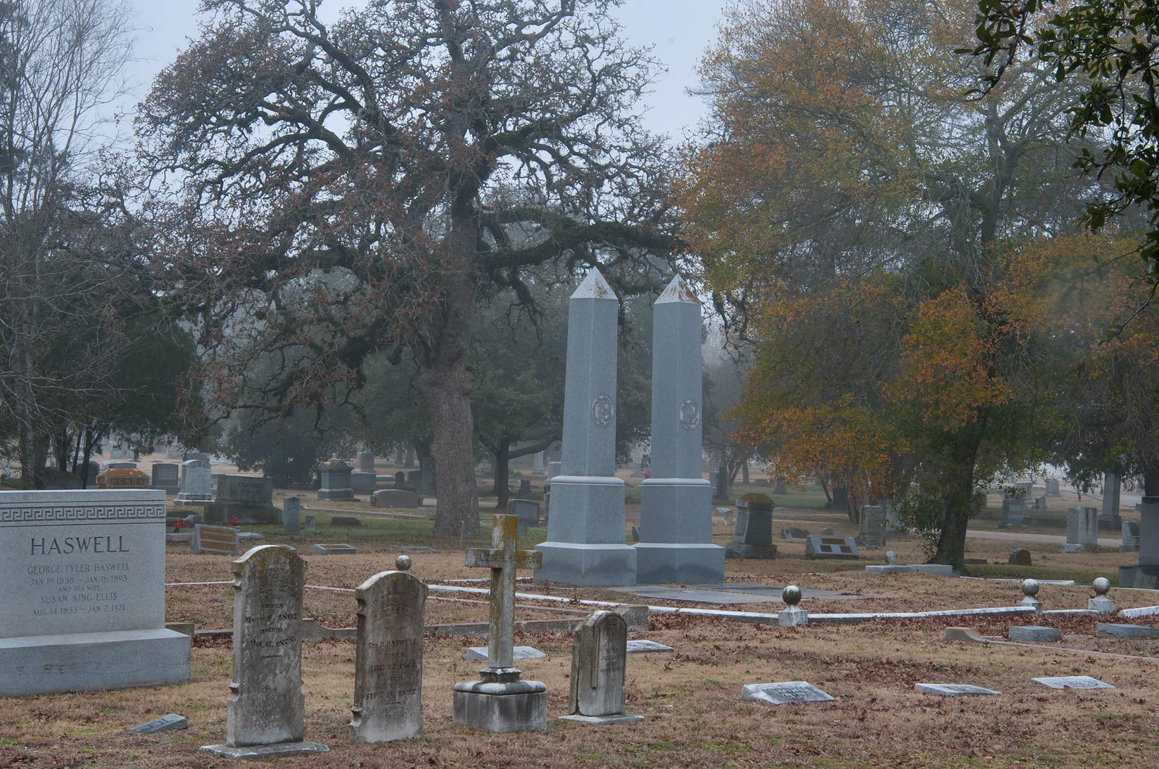 Tombs of City Cemetery in mist. Bryan, Texas