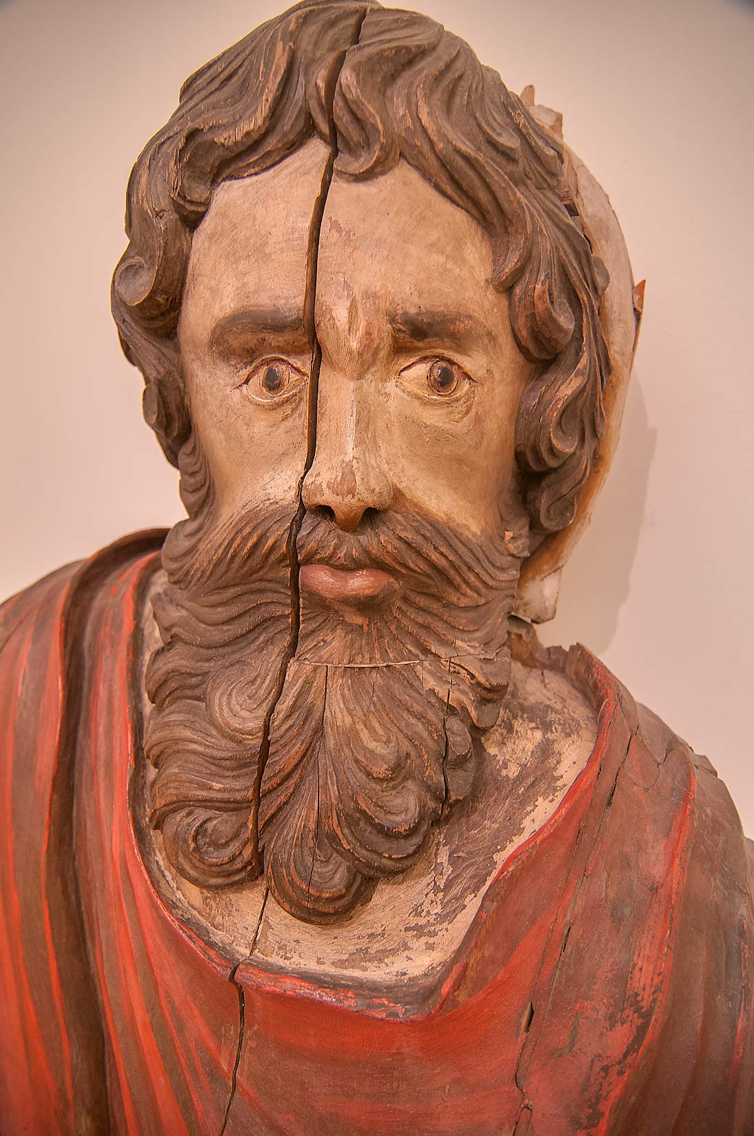 Wooden sculpture of Luke the Evangelist in Russian Museum. St.Petersburg, Russia
