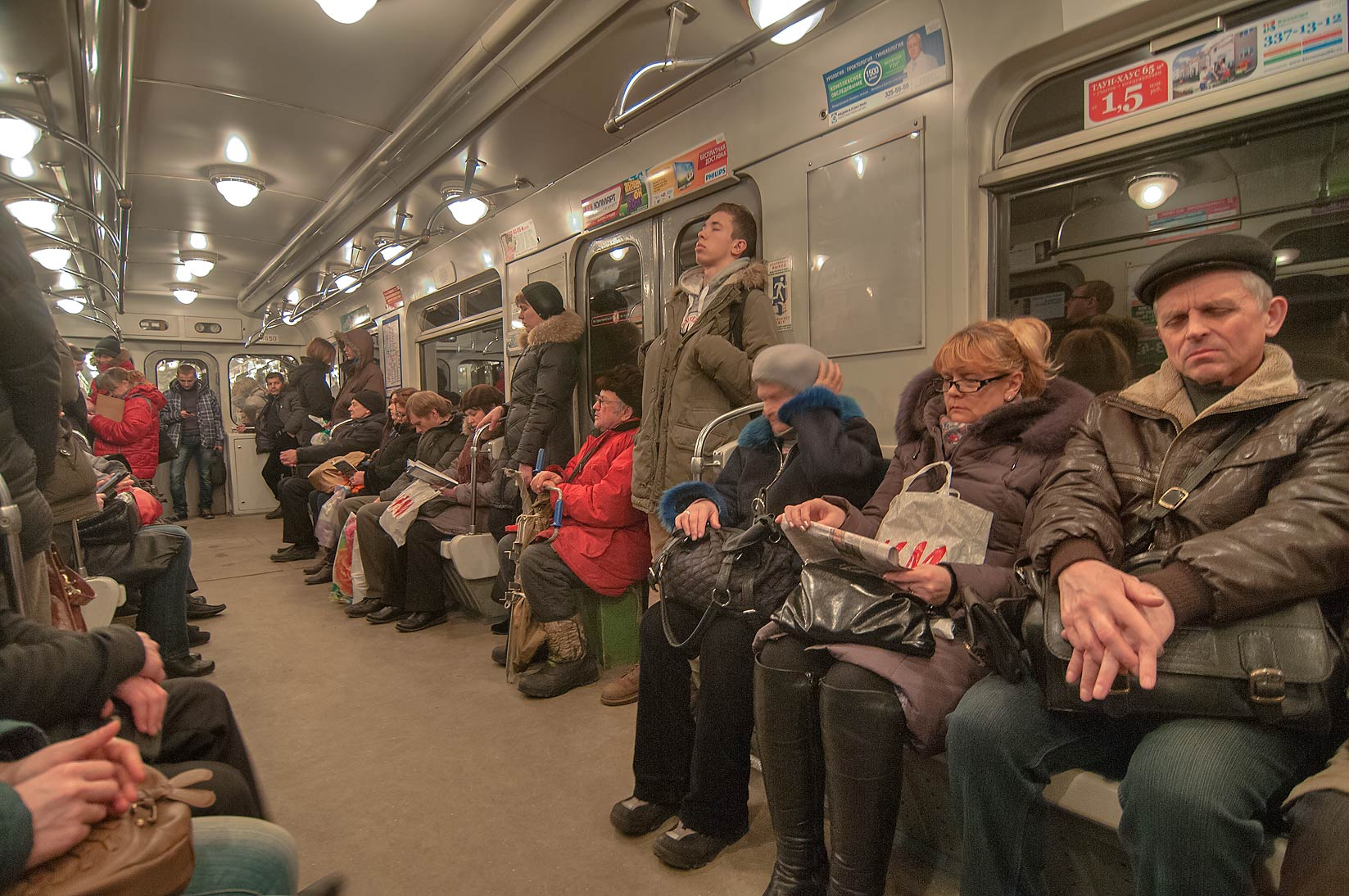 Passengers resting in a carriage of Metro (subway). St.Petersburg, Russia