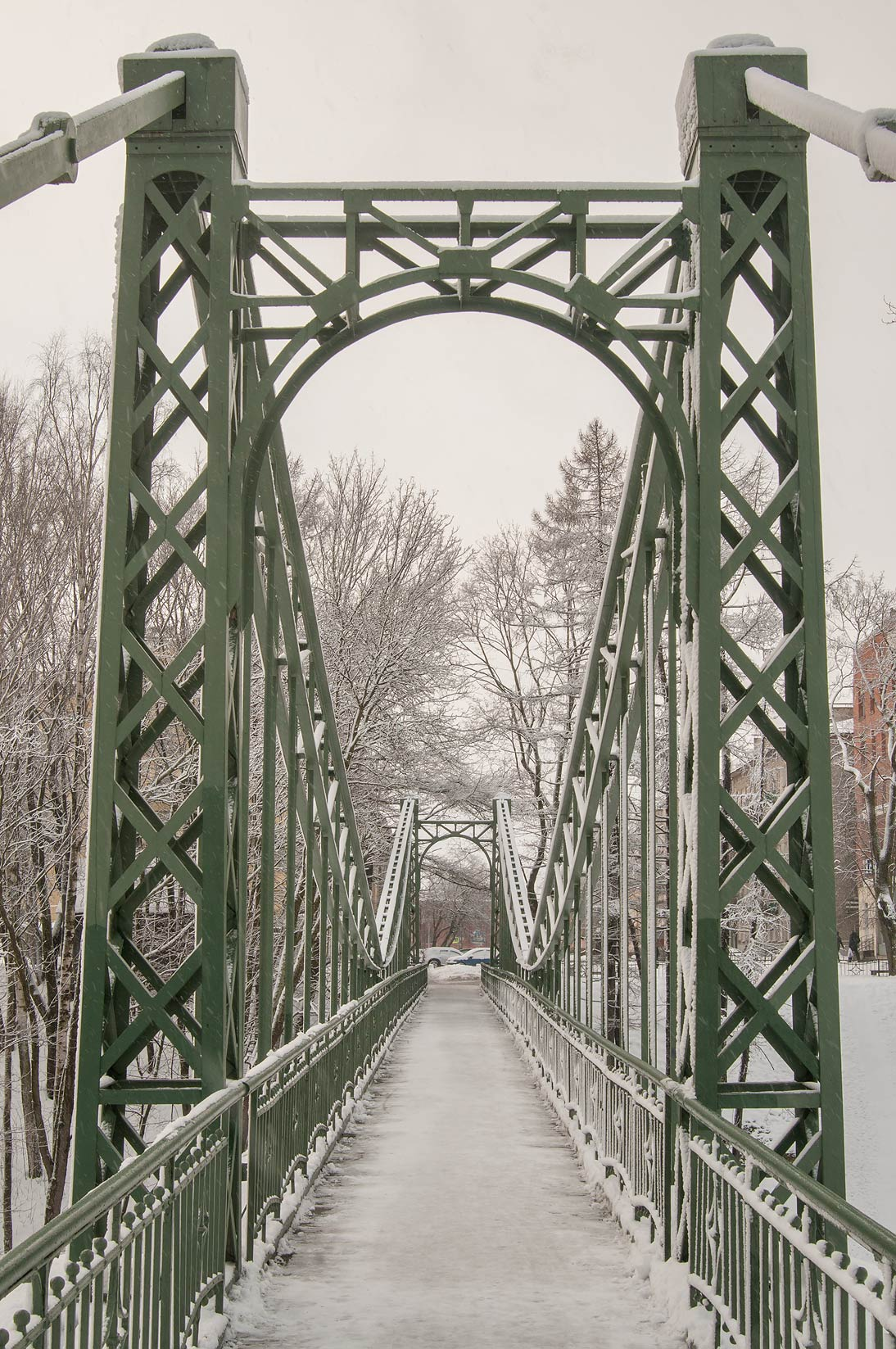 Makarovsky Bridge in snow. Kronstadt (part of St.Petersburg), Russia