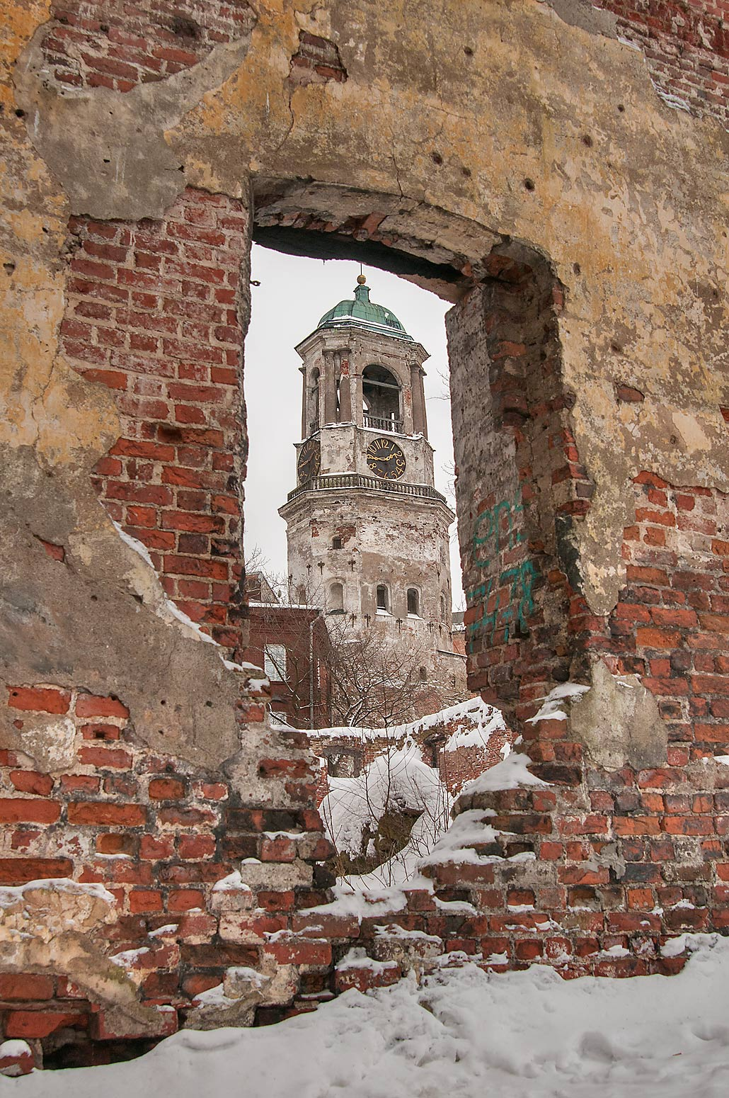 Clock Tower through walls of Mary and Olaf Cathedral. Vyborg, Russia