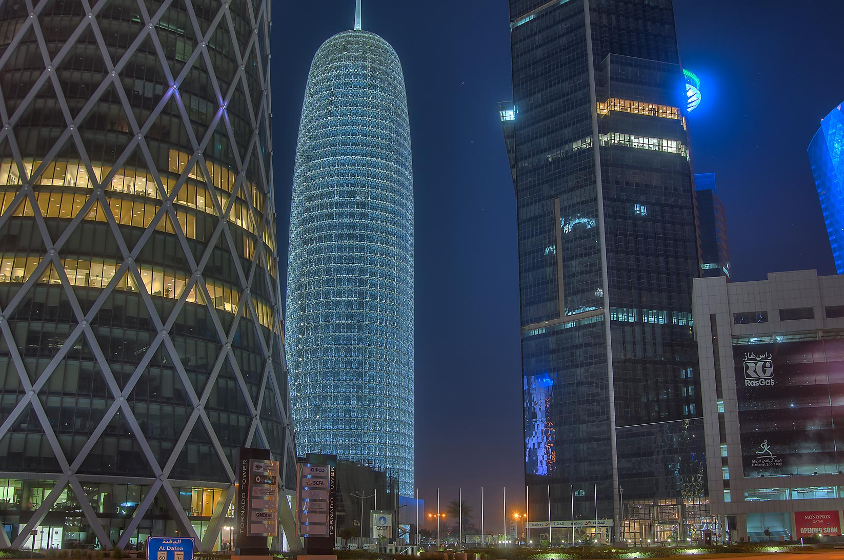 Burj Qatar Tower from the foot of Tornado Tower in West Bay. Doha, Qatar